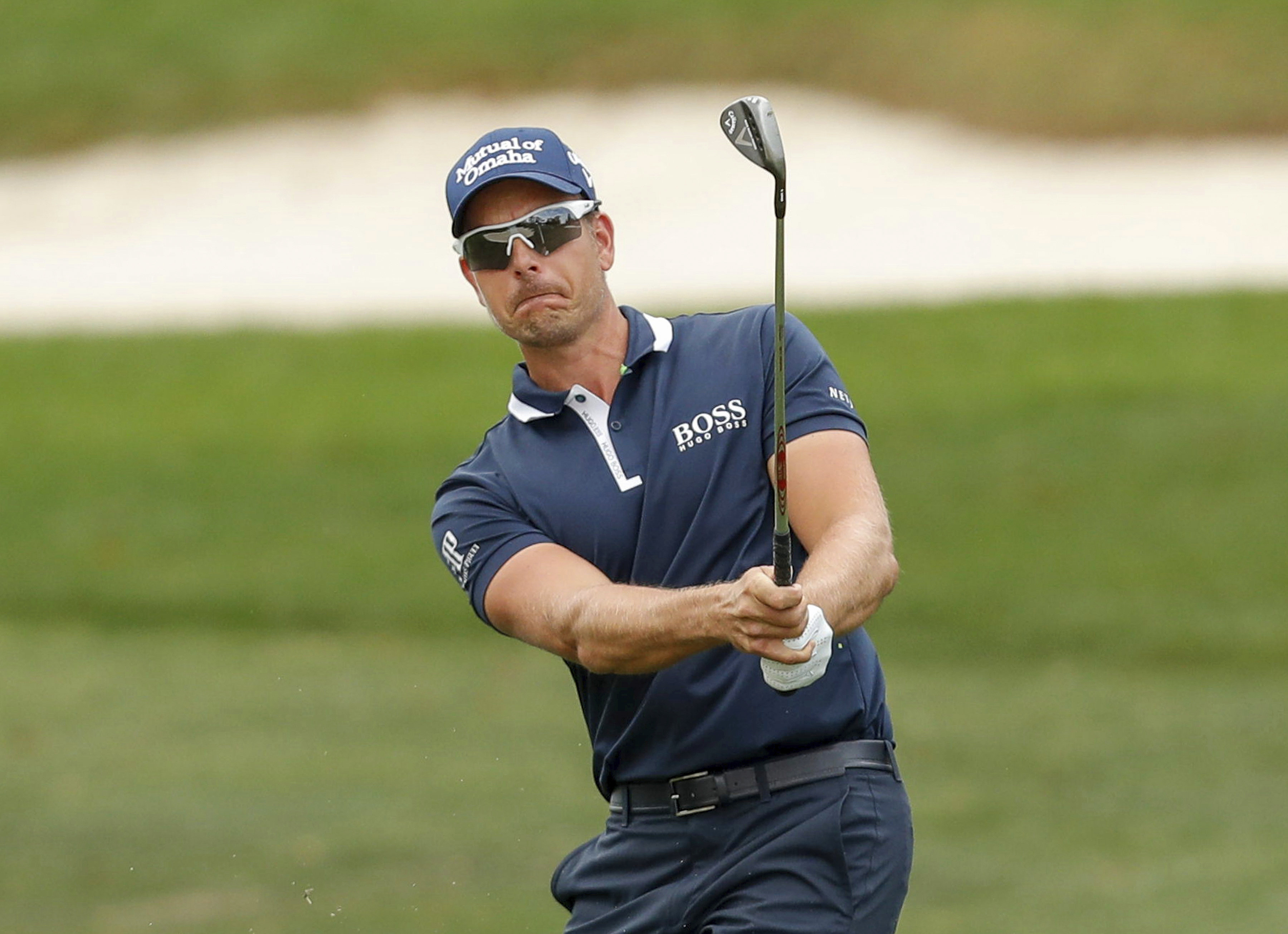 Henrik Stenson, of Sweden, follows through on a chip on the 1st hole during the final round of the Valspar Championship golf tournament, Sunday, March 12, 2017, at Innisbrook in Palm Harbor, Fla. (AP Photo/Mike Carlson)