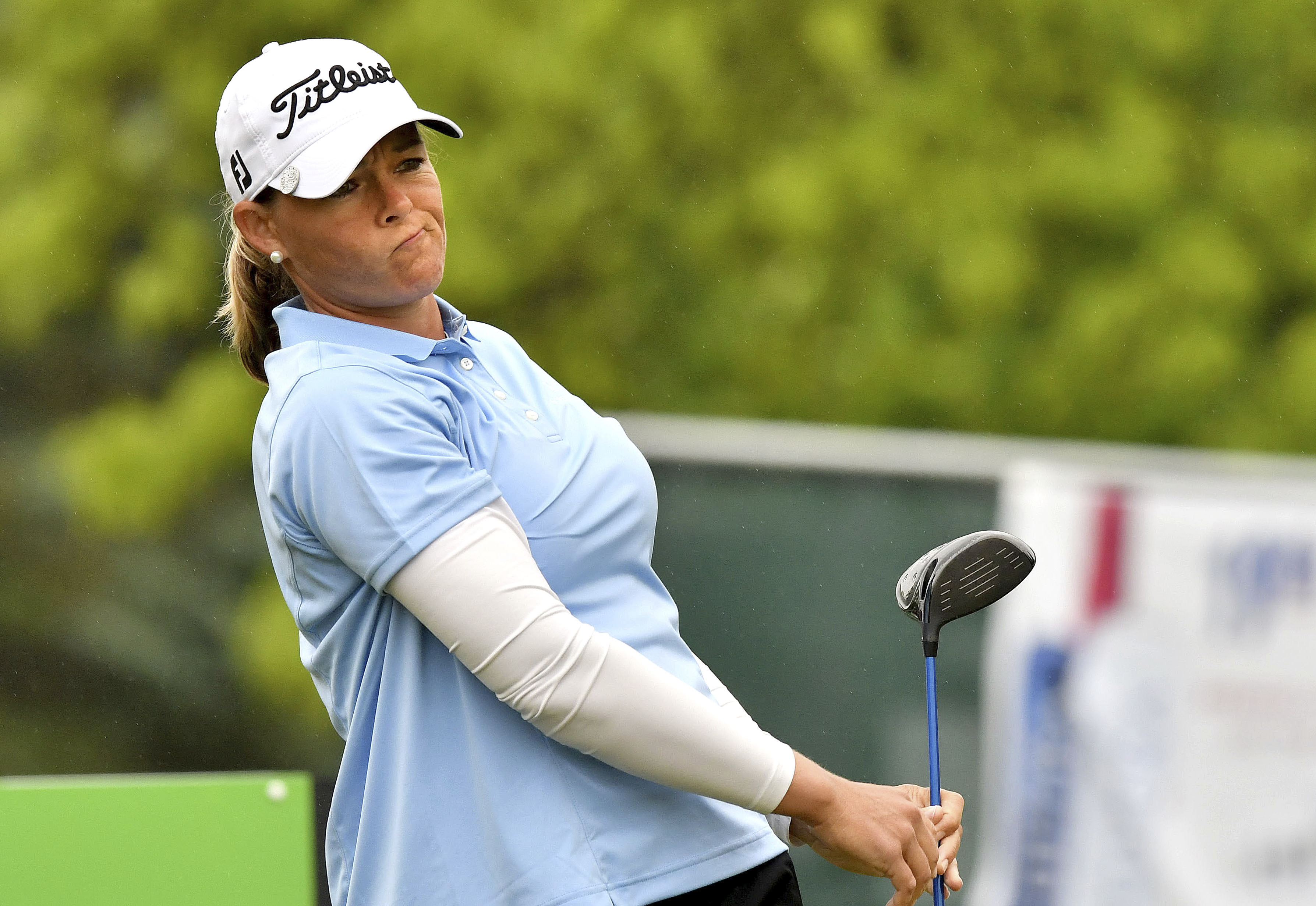 Katherine Kirk watches her shot on the first tee during the first day of the LPGA Volvik Championship, Thursday, May 25, 2016 in Ann Arbor, Mich. (Dale G Young/Detroit News via AP)