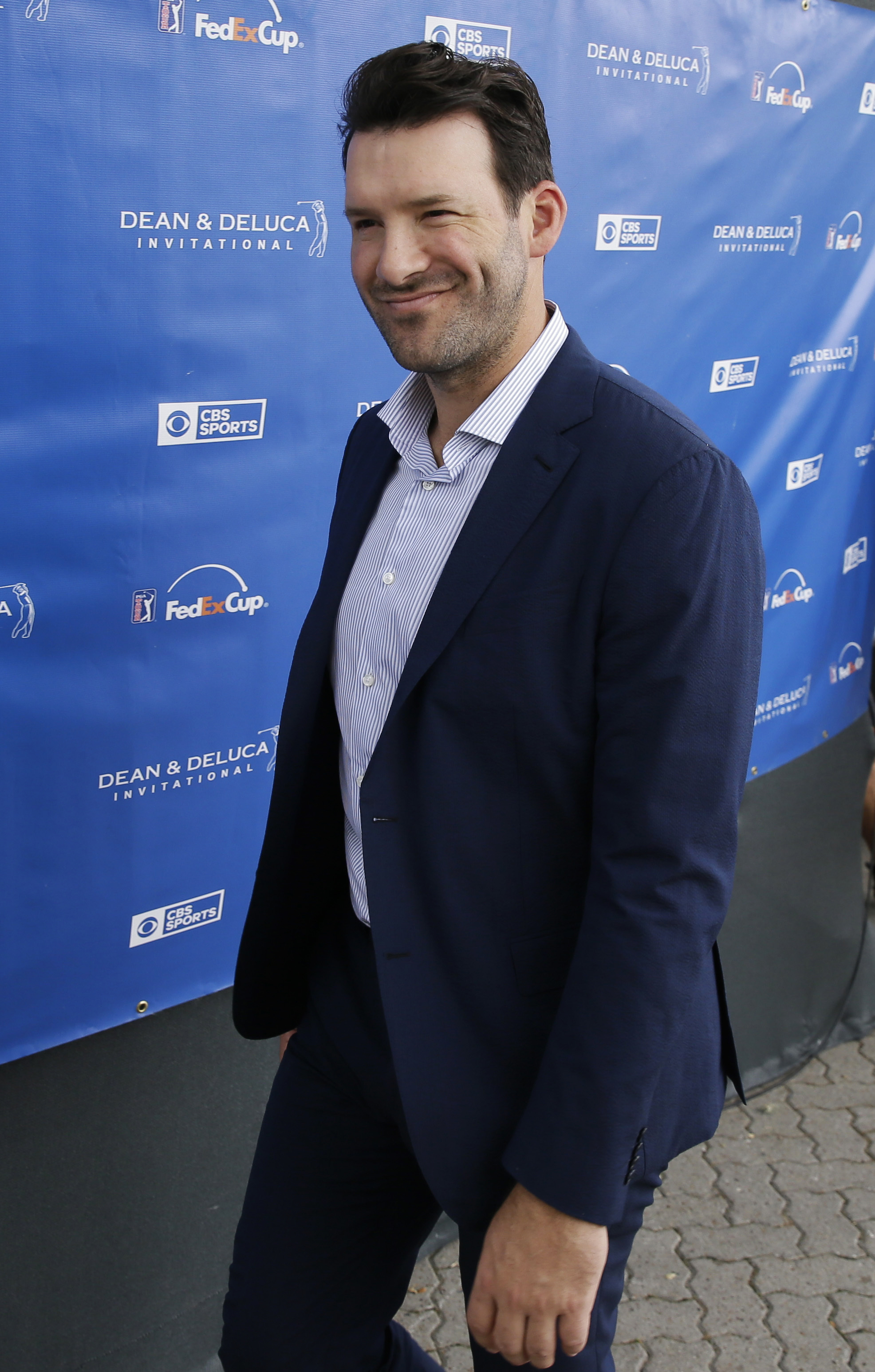Former NFL quarterback Tony Romo leaves the broadcast booth after appearing on air during the third round of the Dean & DeLuca Invitational golf tournament at Colonial Country Club in Fort Worth, Texas, Saturday, May 27, 2017. The former Dallas Cowboys qu