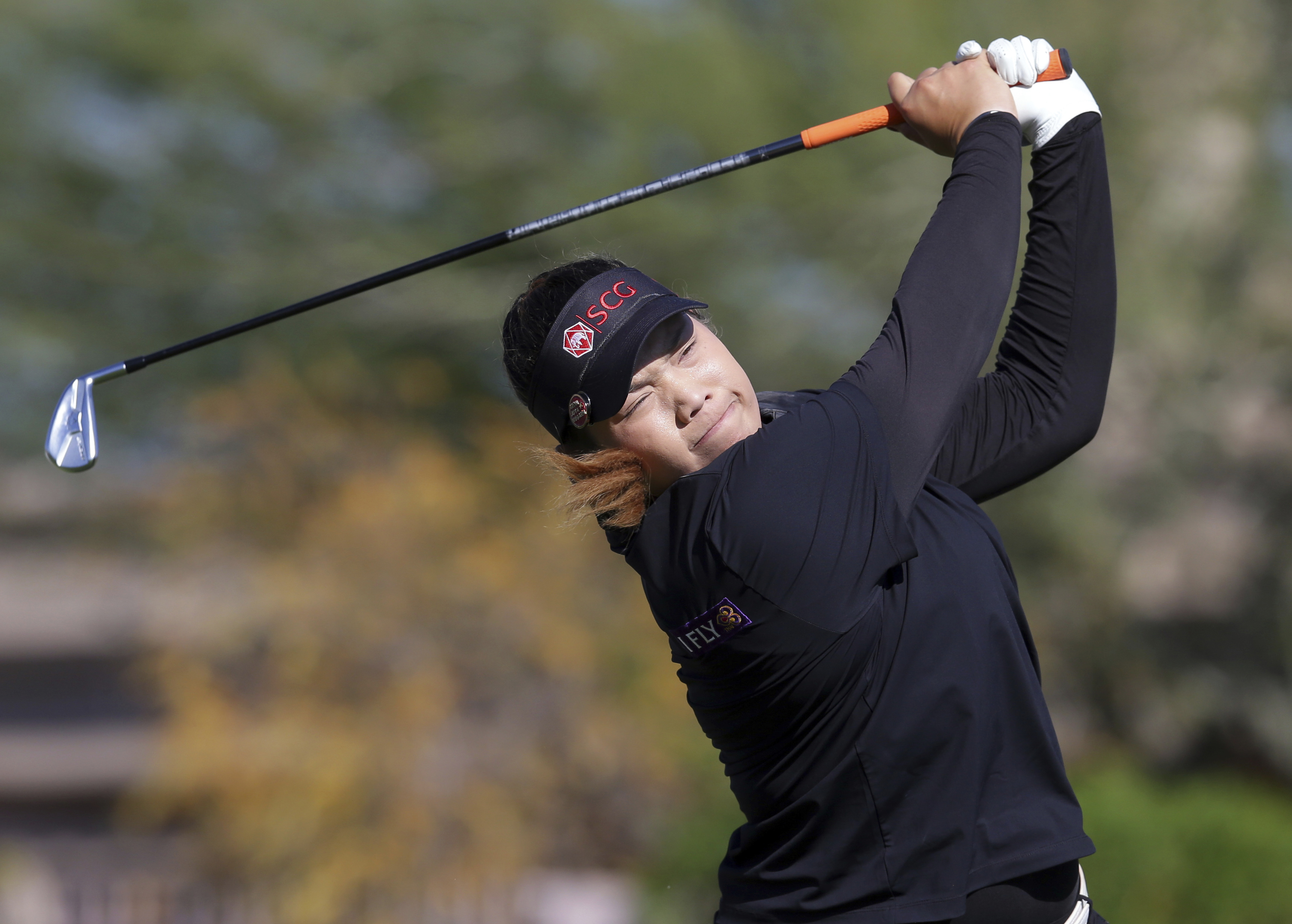 FILE - In this Sunday, March 19, 2017, file photo, Ariya Jutanugarn, of Thailand, tees off on the during the final round of a LPGA golf tournament in Phoenix. Jutanugarn and So Yeon Ryu each had a chance to take over the No. 1 ranking in women's golf over
