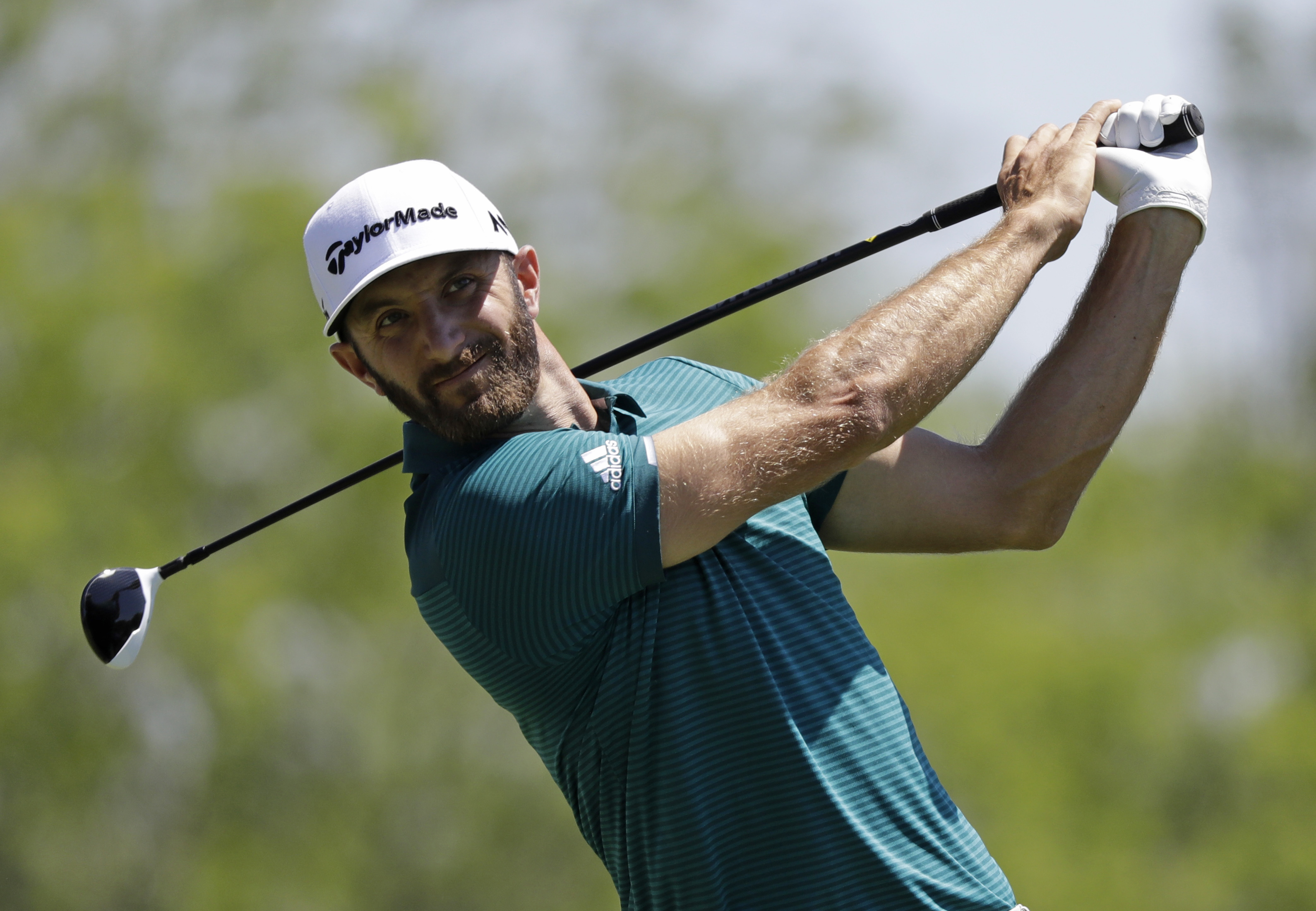 Dustin Johnson tees off on the fifth hole during the second round of the Memorial golf tournament, Friday, June 2, 2017, in Dublin, Ohio. (AP Photo/Darron Cummings)