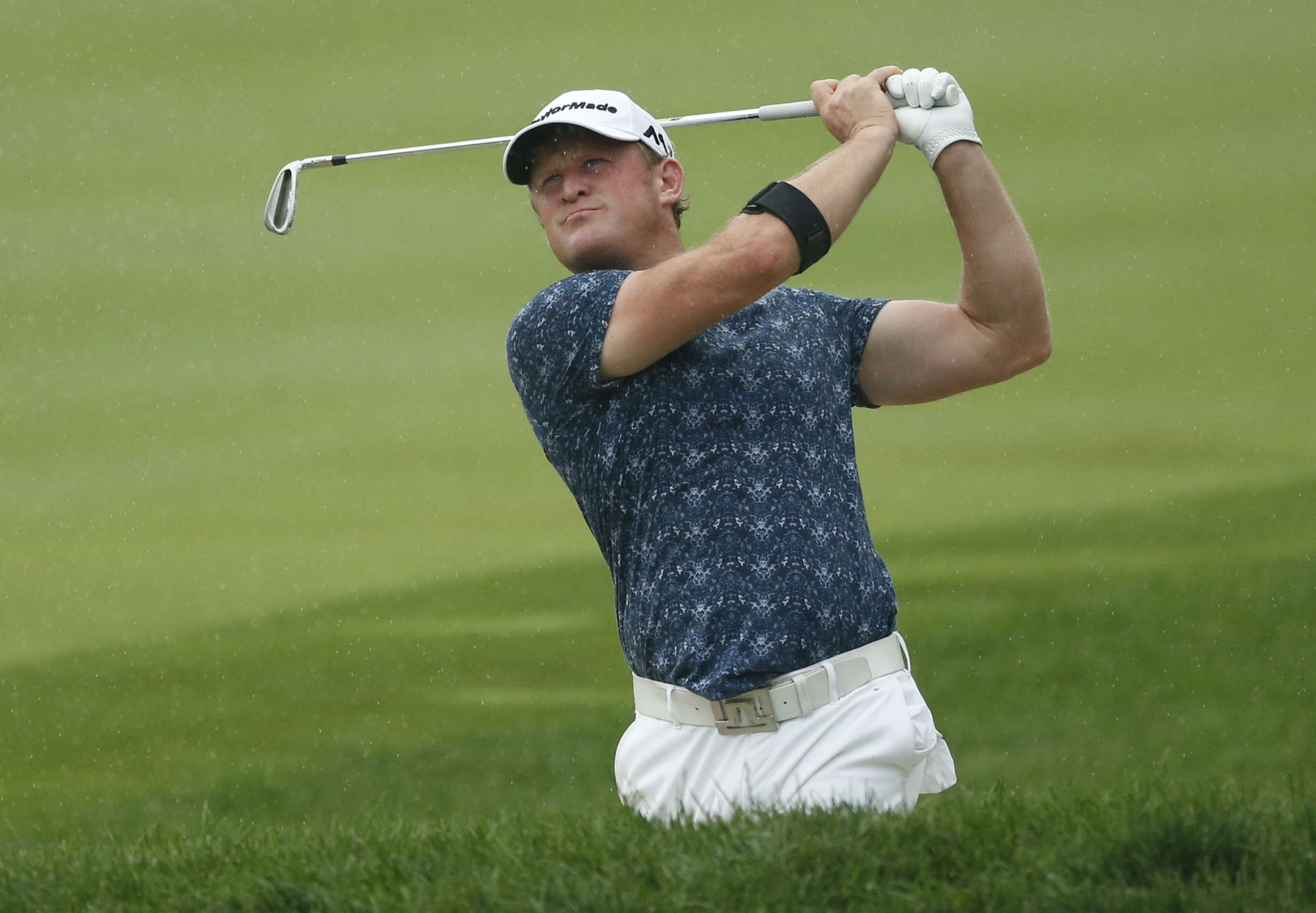 Jamie Donaldson watches his chip shot to the first green during the final round of the PGA Championship golf tournament at Baltusrol Golf Club in Springfield, N.J., Sunday, July 31, 2016. (AP Photo/Mike Groll)