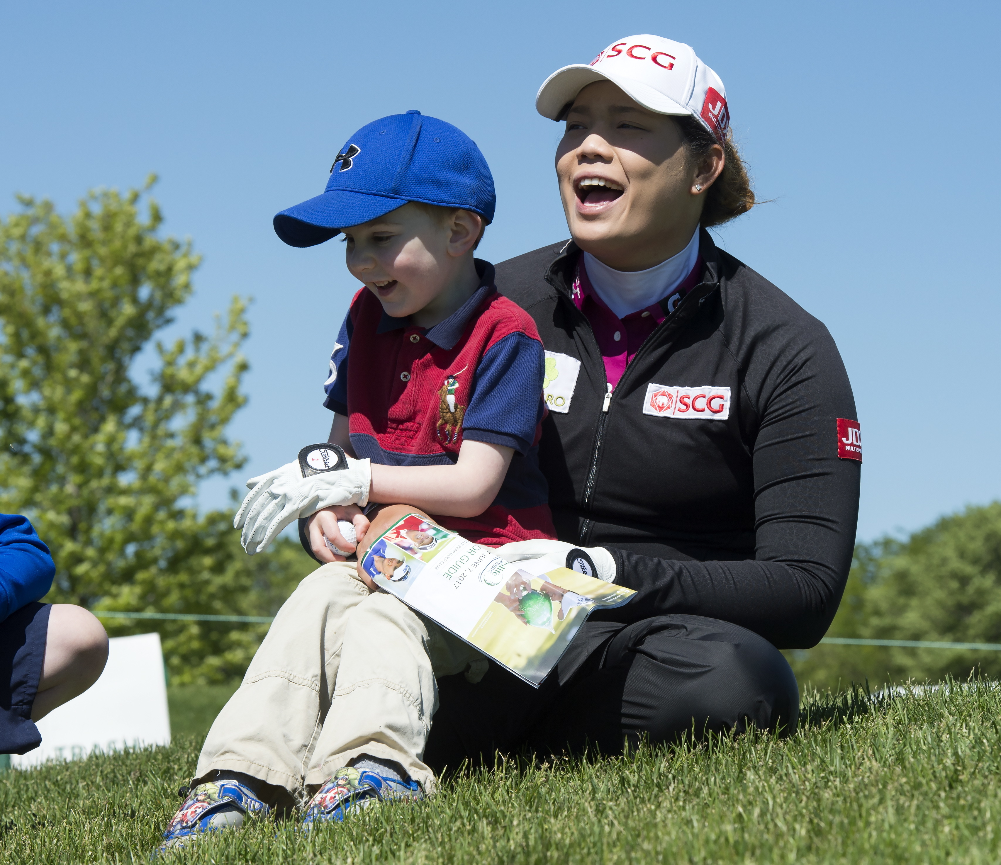 Ariya Jutanugarn, of Thailand, plays with a young fan during the pro-am for the LPGA golf tournament at Whistle Bear Golf Club in Cambridge, Ontario, Wednesday June 7, 2017. (Frank Gunn/The Canadian Press via AP)
