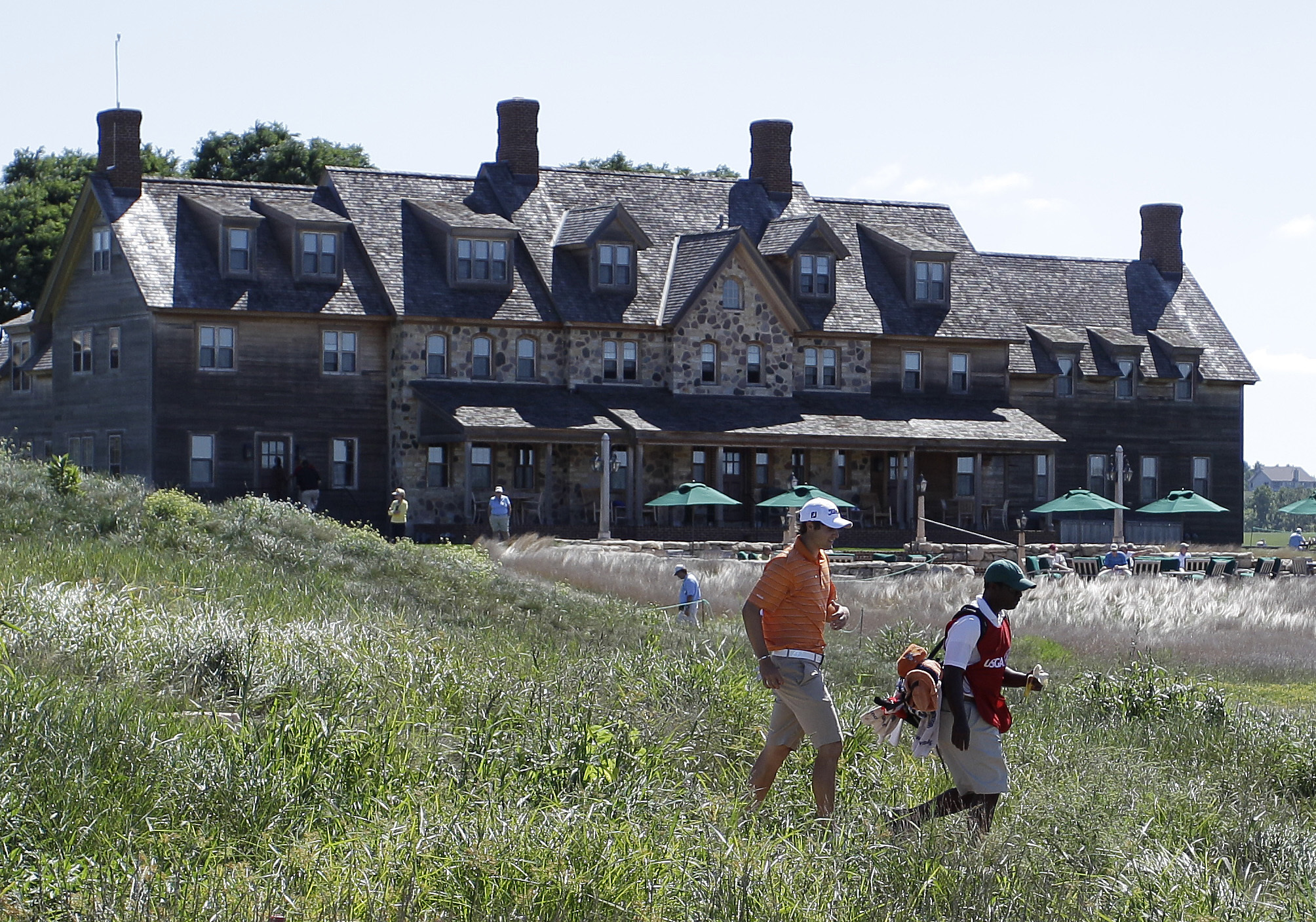 FILE - In this Aug. 25, 2011, file photo, Peter Uihlein of Orlando, Fla., makes his way up the first fairway during the second round of match play at the U.S. Amateur golf tournament at Erin Hills Golf Course in Erin, Wisc. Erin Hills, in the middle of Wi