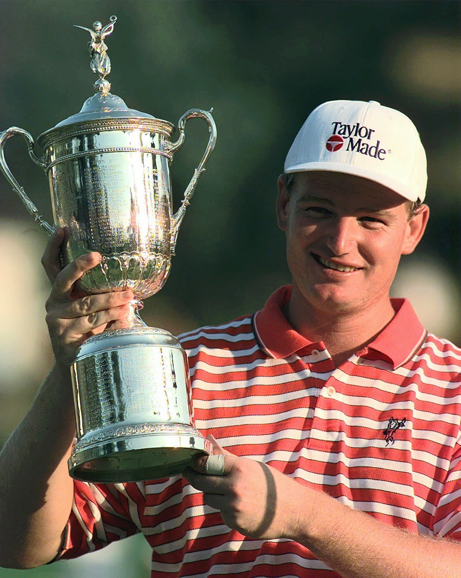 FILE - In this June 15, 1997, file photo, Ernie Els holds up the trophy after winning the U.S. Open golf tournament at Congressional Country Club in Bethesda, Md. In the first major since 21-year-old Tiger Woods won the Masters by 12 shots, Els was the fi