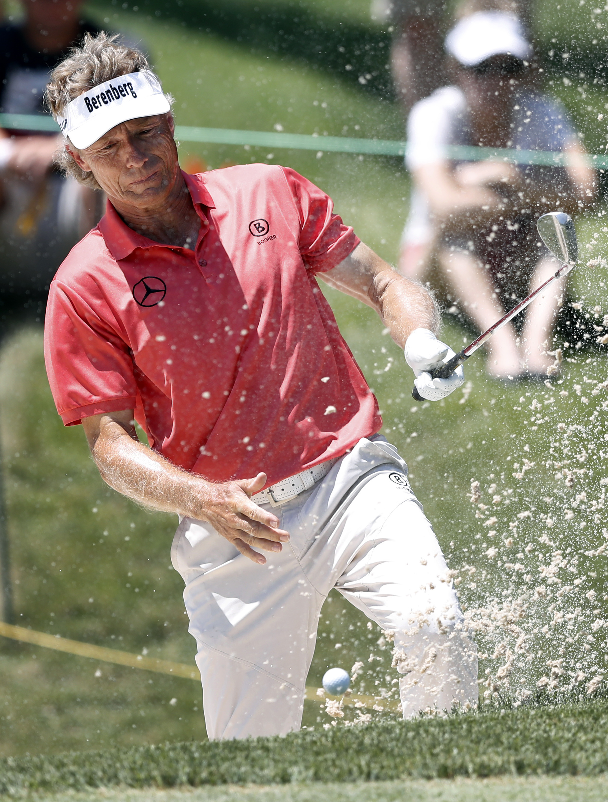 Bernhard Langer reacts to his bunker shot on the ninth hole during the second round of the PGA Tour Champions Principal Charity Classic golf tournament, Saturday, June 10, 2017, in Des Moines, Iowa. (AP Photo/Charlie Neibergall)