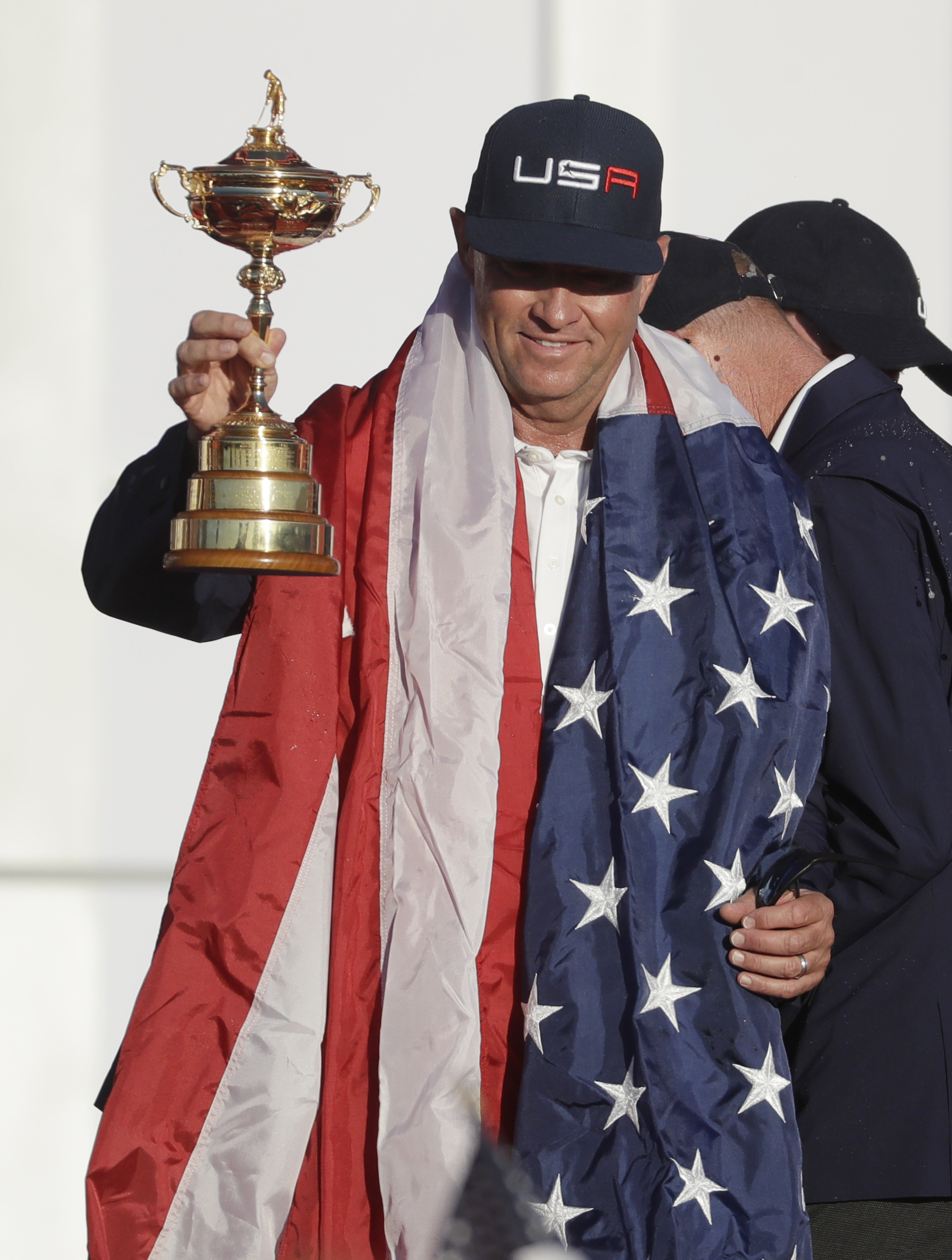 United States captain Davis Love III holds up the Ryder Cup during the closing ceremony of the golf tournament Sunday, Oct. 2, 2016, at Hazeltine National Golf Club in Chaska, Minn. (AP Photo/Chris Carlson)