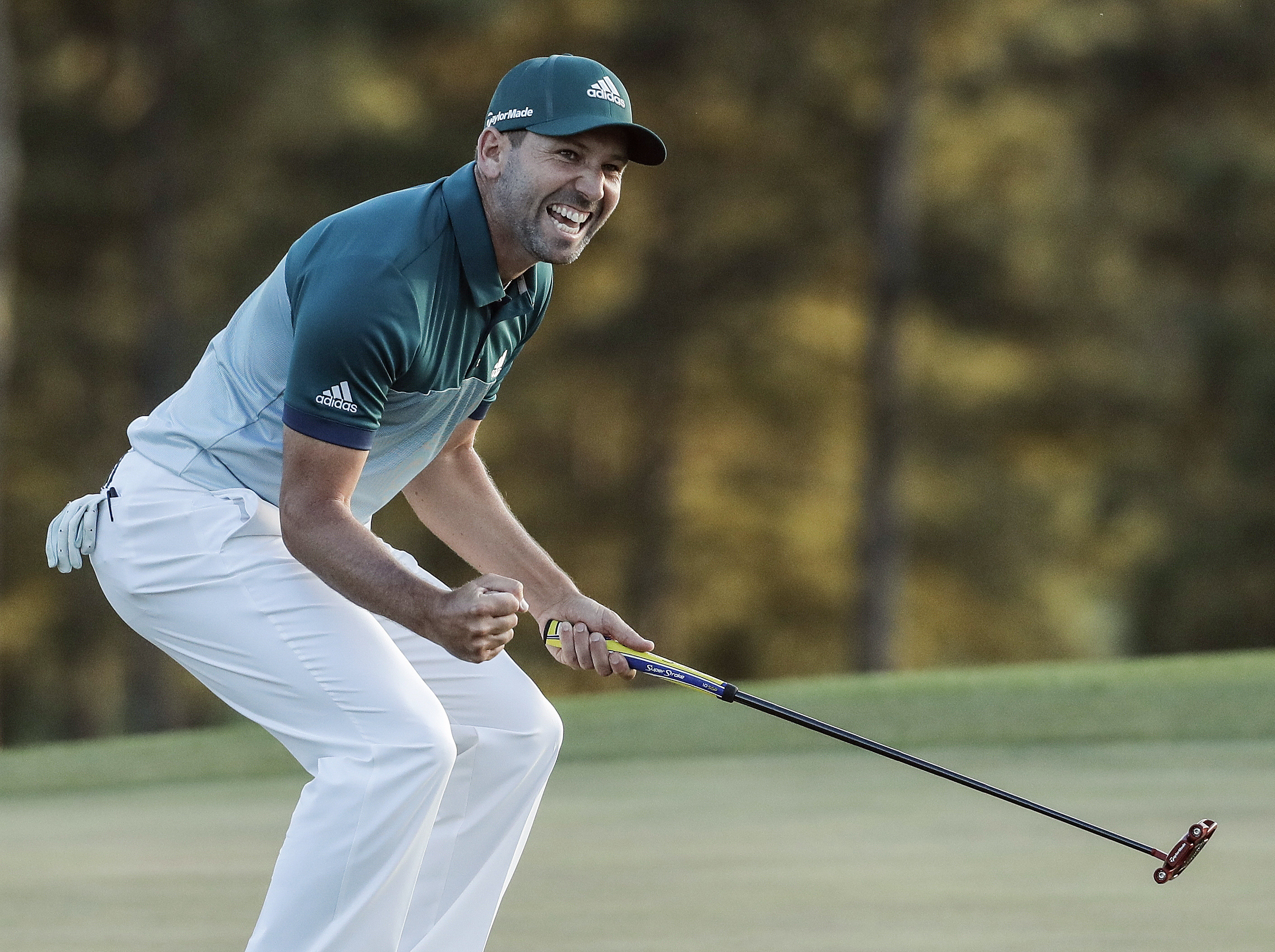 FILE - In  this April 9, 2017, file photo, Sergio Garcia, of Spain, reacts after making his birdie putt on the 18th green to win the Masters golf tournament in a playoff in Augusta, Ga. Garcia is loving his time at the U.S. Open, having finally captured t