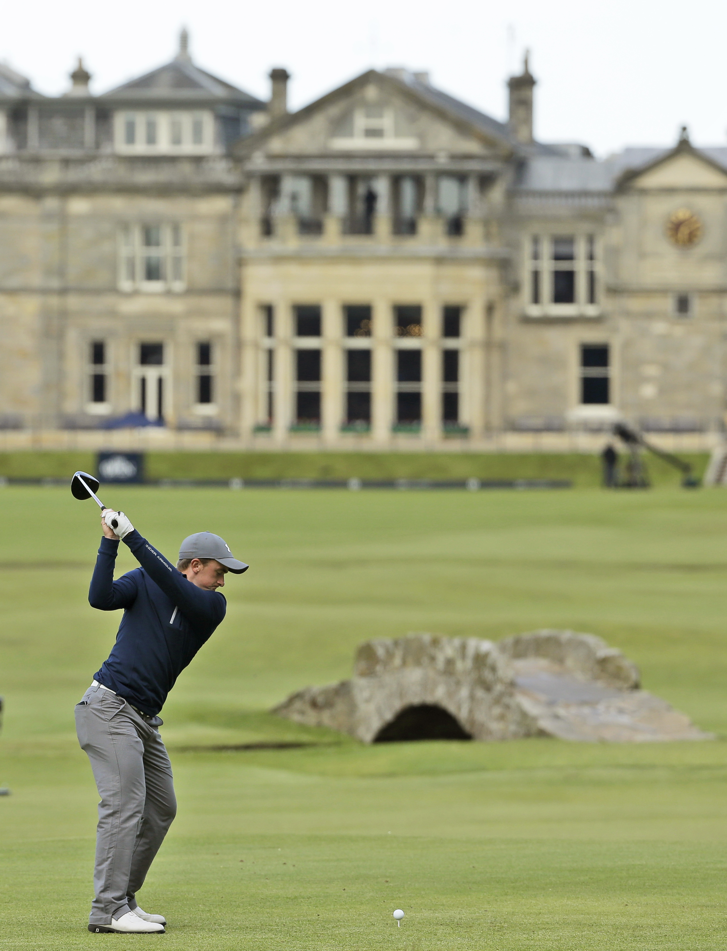 FILE - In this July 19, 2015, file photo, Ireland's Paul Dunne plays from the 18th tee during the third round at the British Open golf tournament at the Old Course, St. Andrews, Scotland. Dunne shared the 54-hole lead, but bell back quickly in the final r