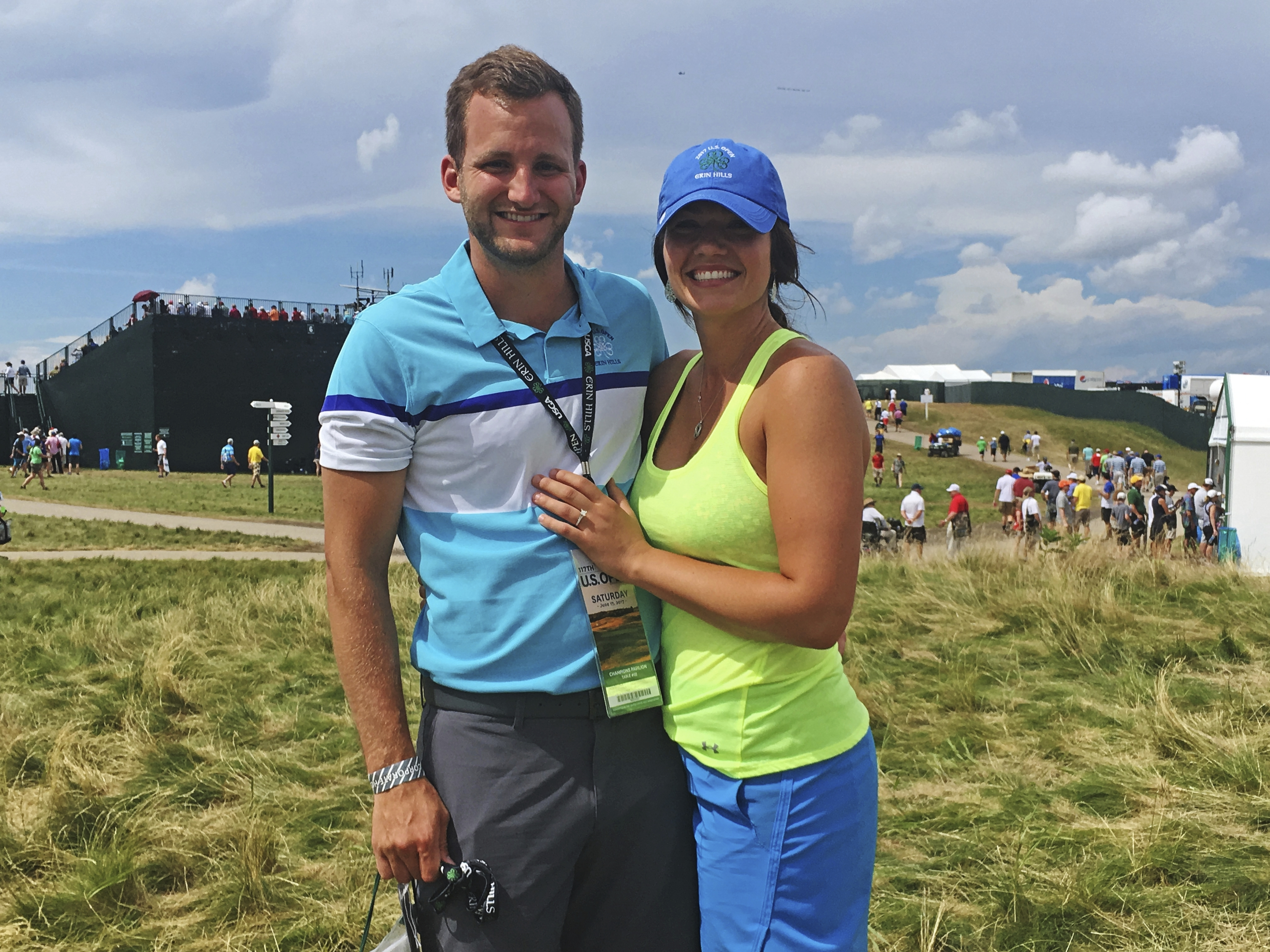 Malea Blise poses with her engagement ring after Nick Rogness proposed to her during the third round of the U.S. Open golf tournament Saturday, June 17, 2017, at Erin Hills in Erin, Wis. (AP Photo/Doug Ferguson)
