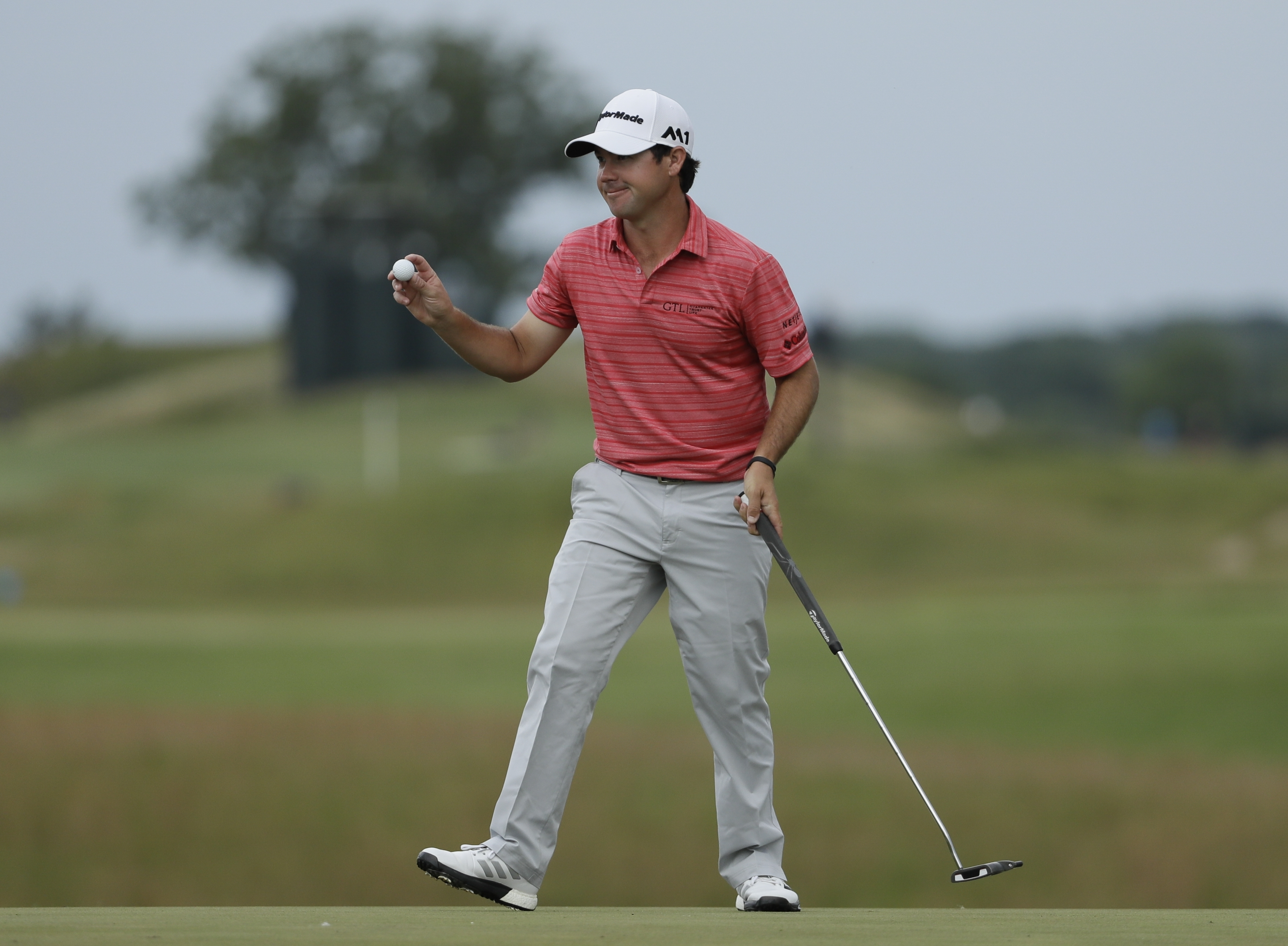 Brian Harman reacts on the 18th hole during the third round of the U.S. Open golf tournament Saturday, June 17, 2017, at Erin Hills in Erin, Wis. (AP Photo/David J. Phillip)