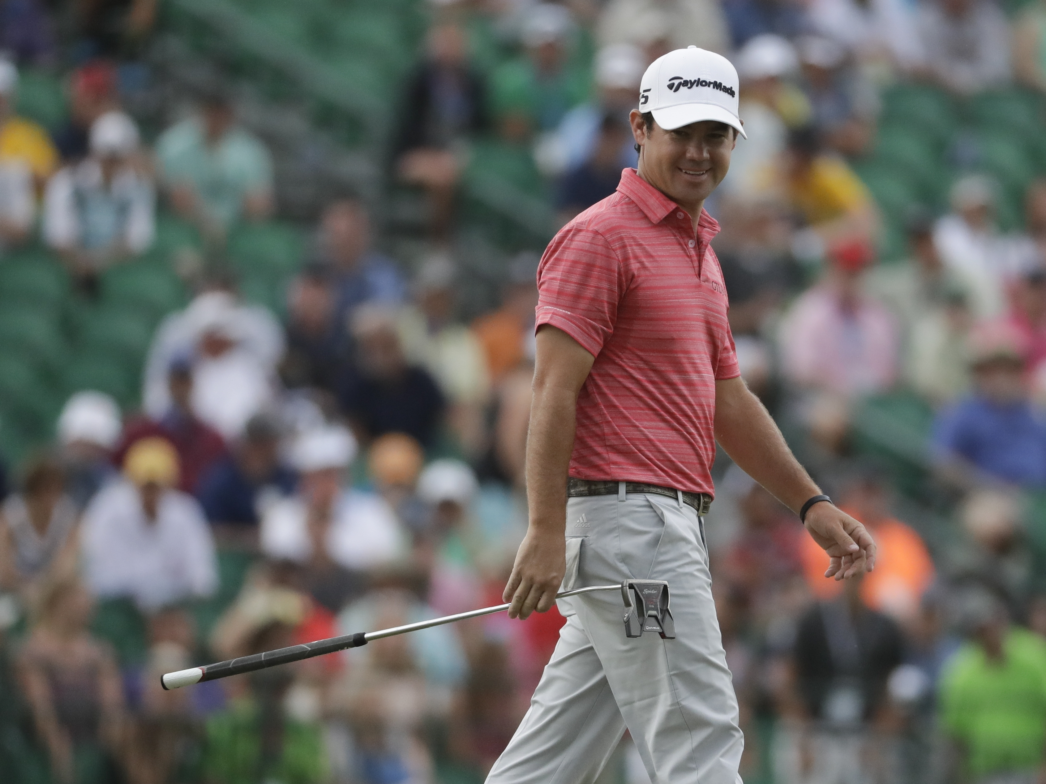 Brian Harman smiles on the 18th green during the third round of the U.S. Open golf tournament Saturday, June 17, 2017, at Erin Hills in Erin, Wis. (AP Photo/Chris Carlson)