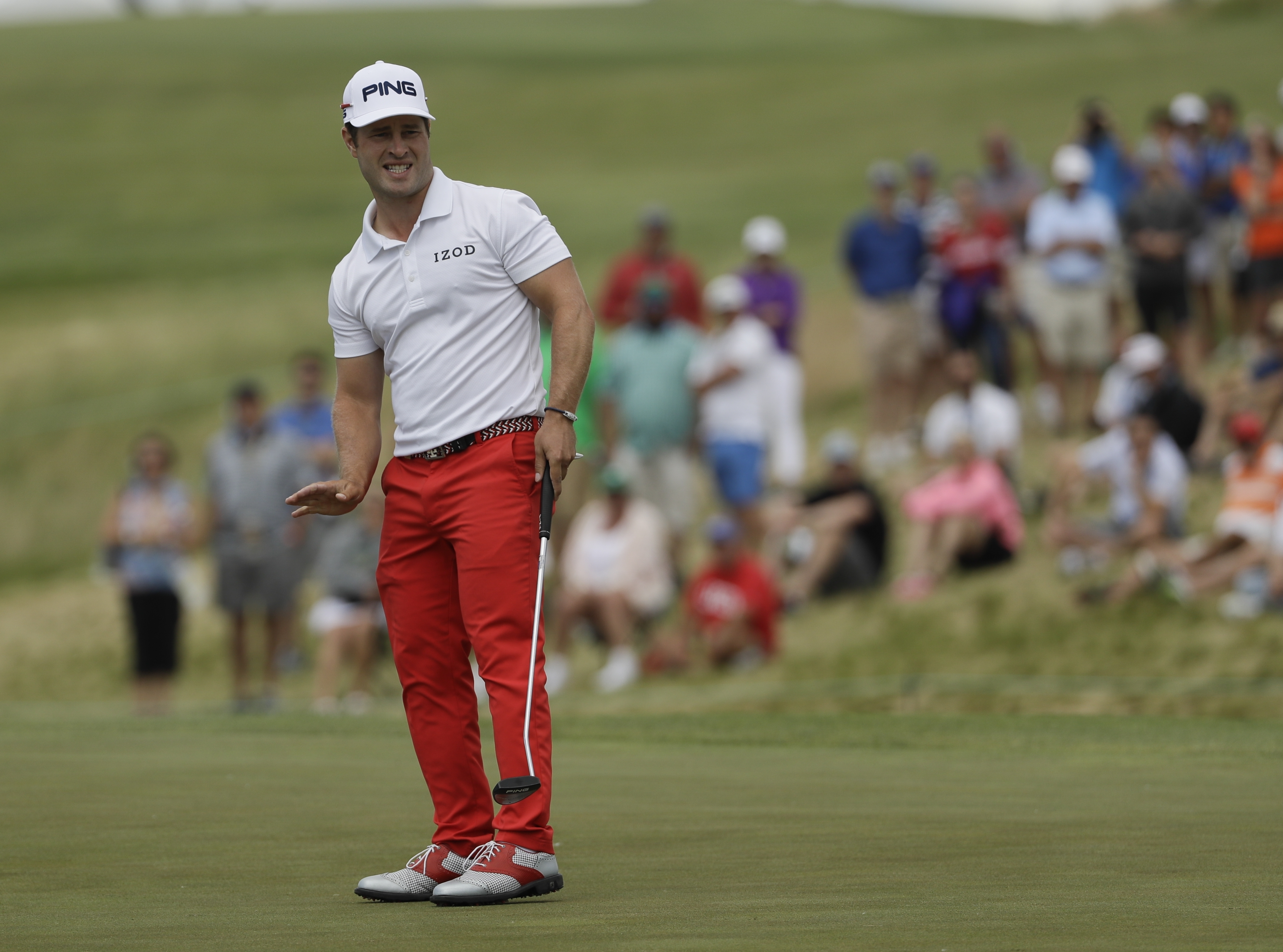 David Lingmerth, of Sweden, reacts to his putt on the ninth hole during the fourth round of the U.S. Open golf tournament Sunday, June 18, 2017, at Erin Hills in Erin, Wis. (AP Photo/David J. Phillip)
