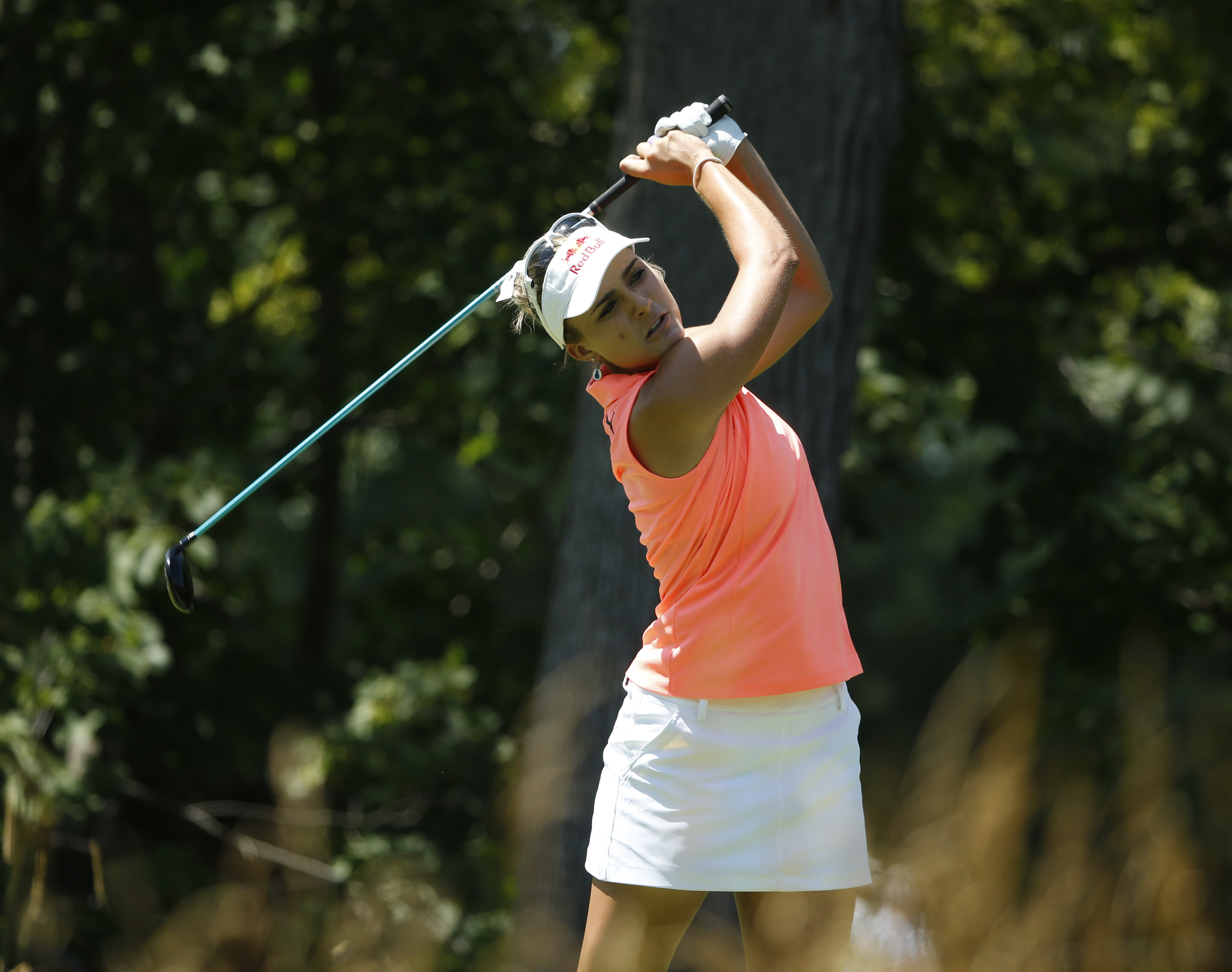 Lexi Thompson watches her tee shot on the fifth hole during the third round of the Women's PGA Championship golf tournament at Olympia Fields Country Club Saturday, July 1, 2017, in Olympia Fields, Ill. (AP Photo/Charles Rex Arbogast)