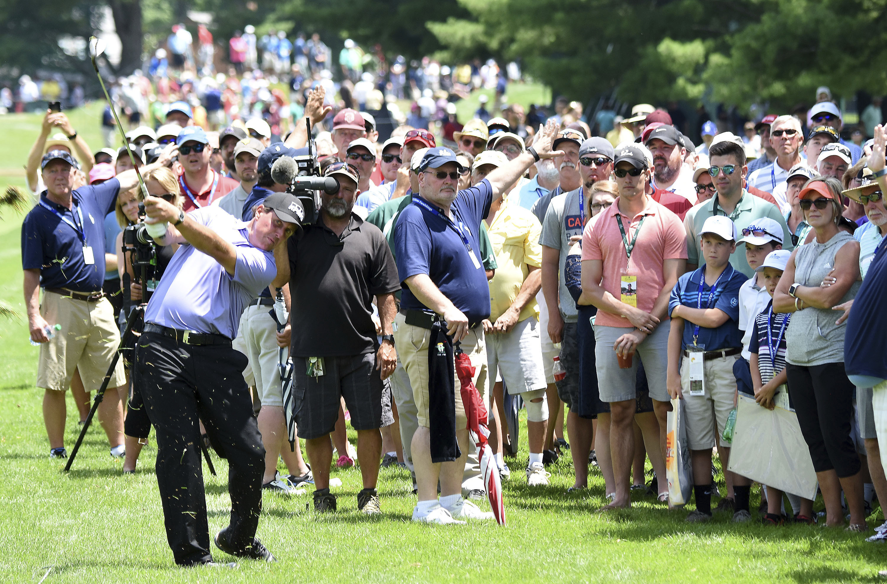 Phil Mickelson hits his second shot on the ninth hole during the second round of The Greenbrier Classic golf tournament Friday, July 7, 2017, in White Sulphur Springs, W.Va. (Rick Barbero/The Register-Herald via AP)