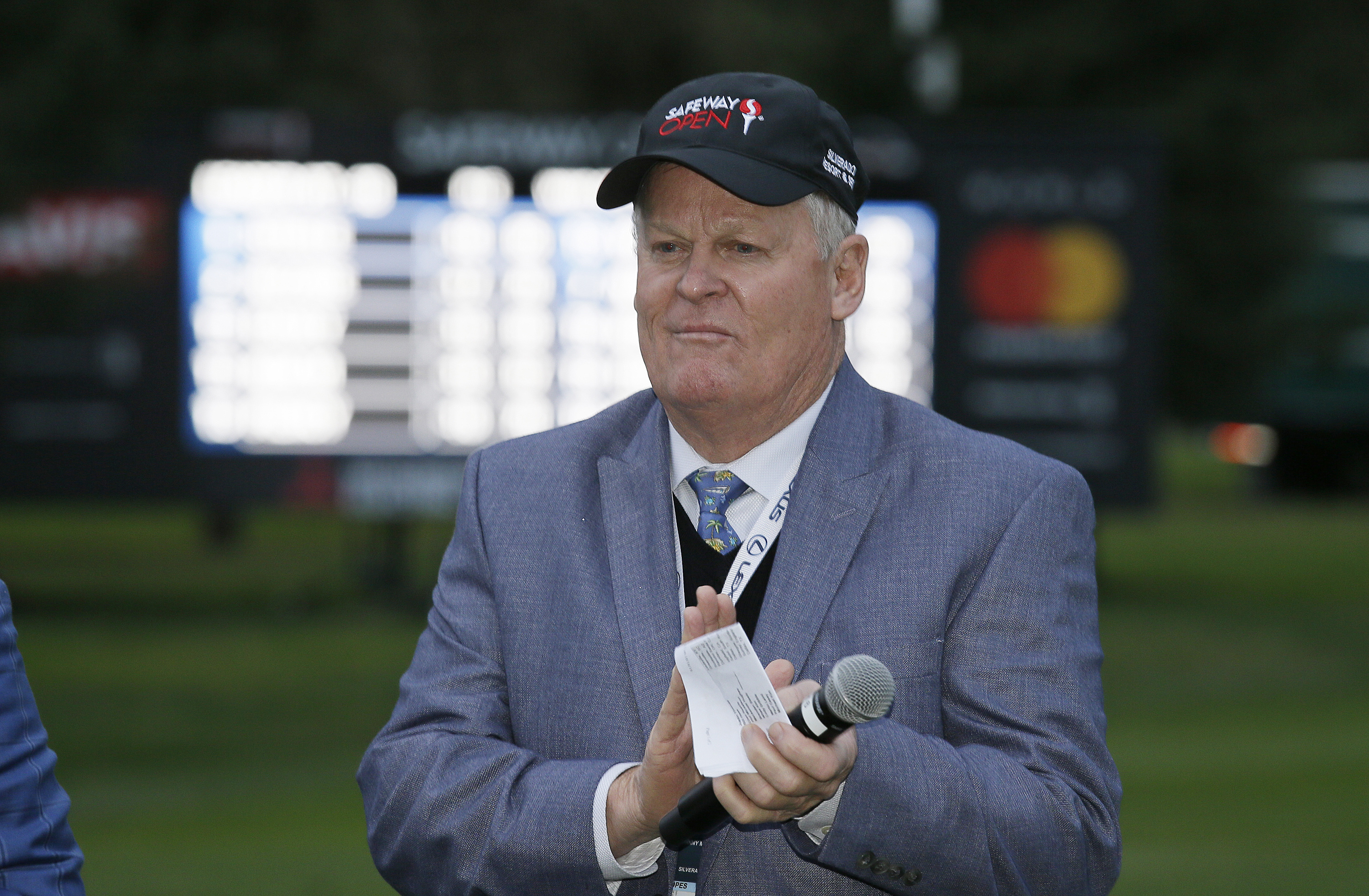 FILE - In this Oct. 16, 2016, file photo, Johnny Miller stands on the 18th green of the Silverado Resort North Course during the trophy presentation of the Safeway Open PGA golf tournament, in Napa, Calif. Television viewers haven't heard the last of John