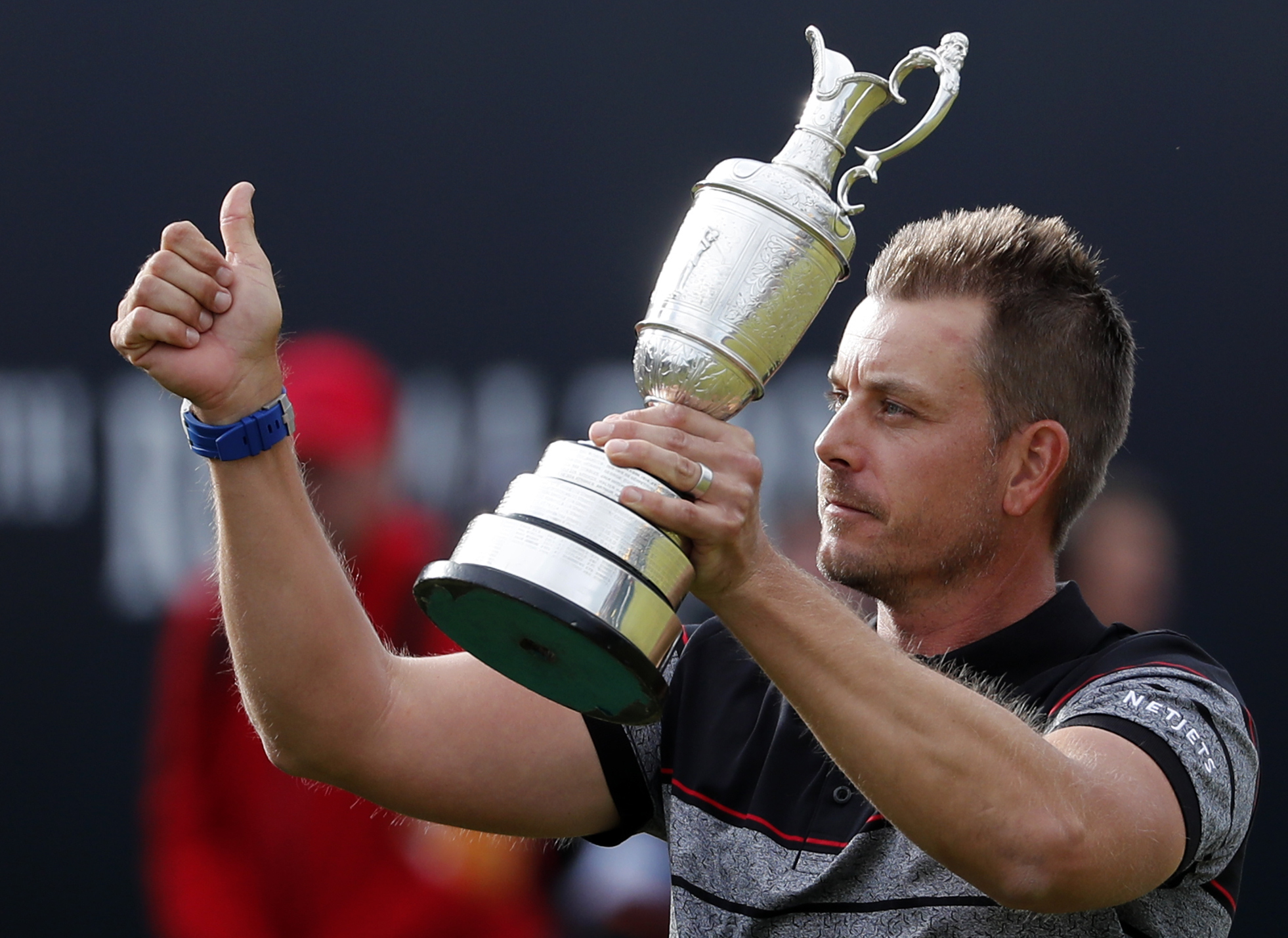 FILE - This is a Sunday, July 17, 2016  file photo of Henrik Stenson of Sweden holds up the trophy tom the crowd after winning the British Open Golf Championships at the Royal Troon Golf Club in Troon, Scotland.  Swedish golfer  Henrik Stenson golfer is p