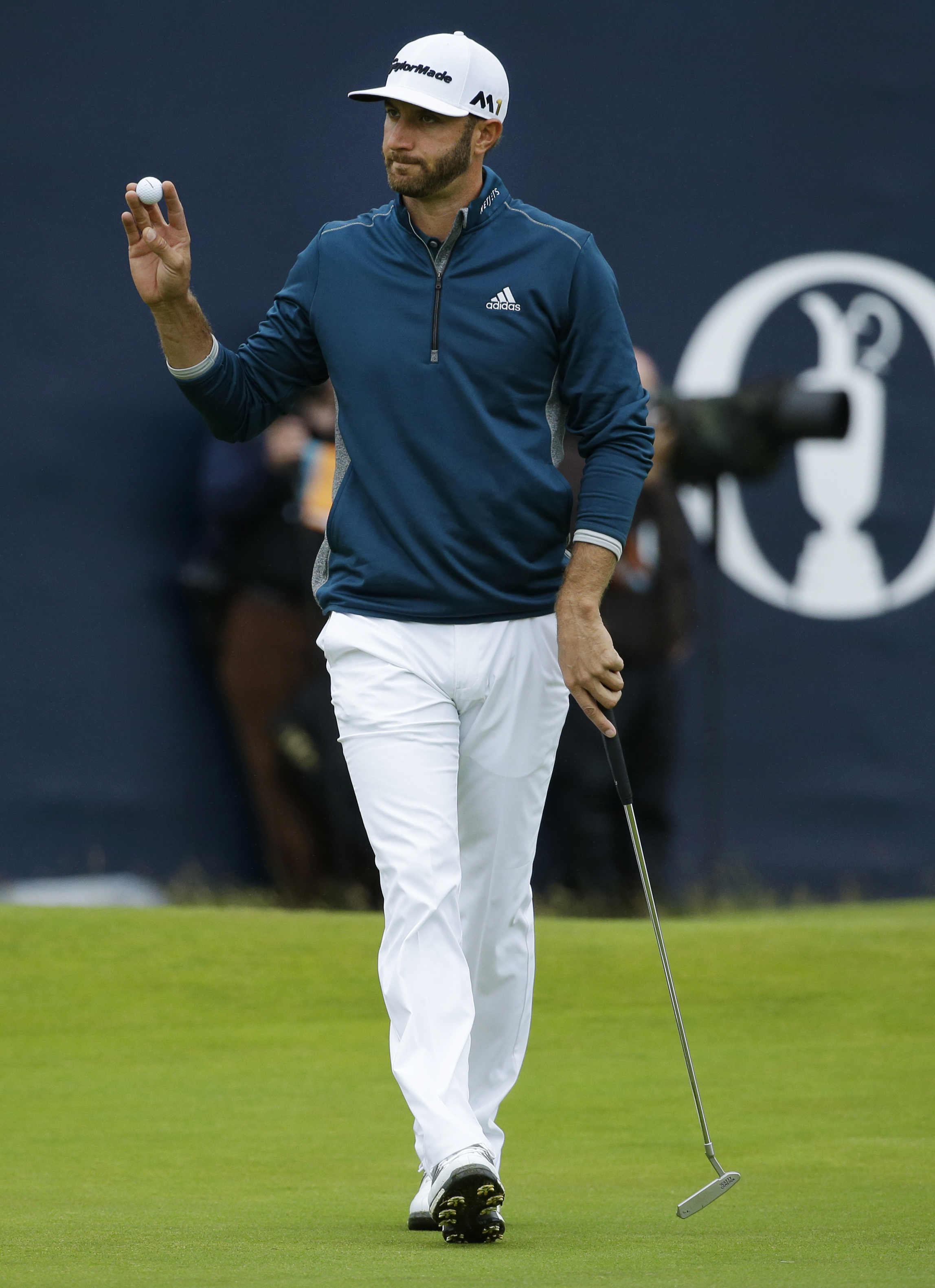FILE - In this Friday, July 15, 2016, file photo, Dustin Johnson of the United States acknowledges the crowd as he walks off the 18th green after completing his second round of the British Open Golf Championships at the Royal Troon Golf Club in Troon, Sco