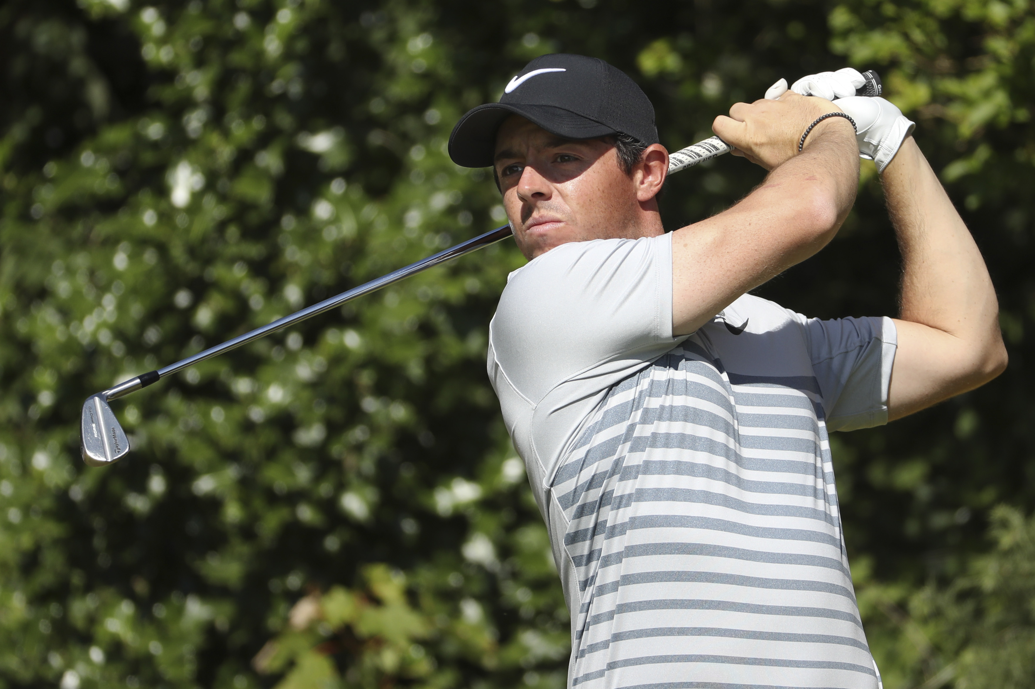 Northern Ireland's Rory McIlroy plays a shot from the 5th tee during a practice round ahead of the British Open Golf Championship, at Royal Birkdale, Southport, England Tuesday, July 18, 2017. (AP Photo/Peter Morrison)