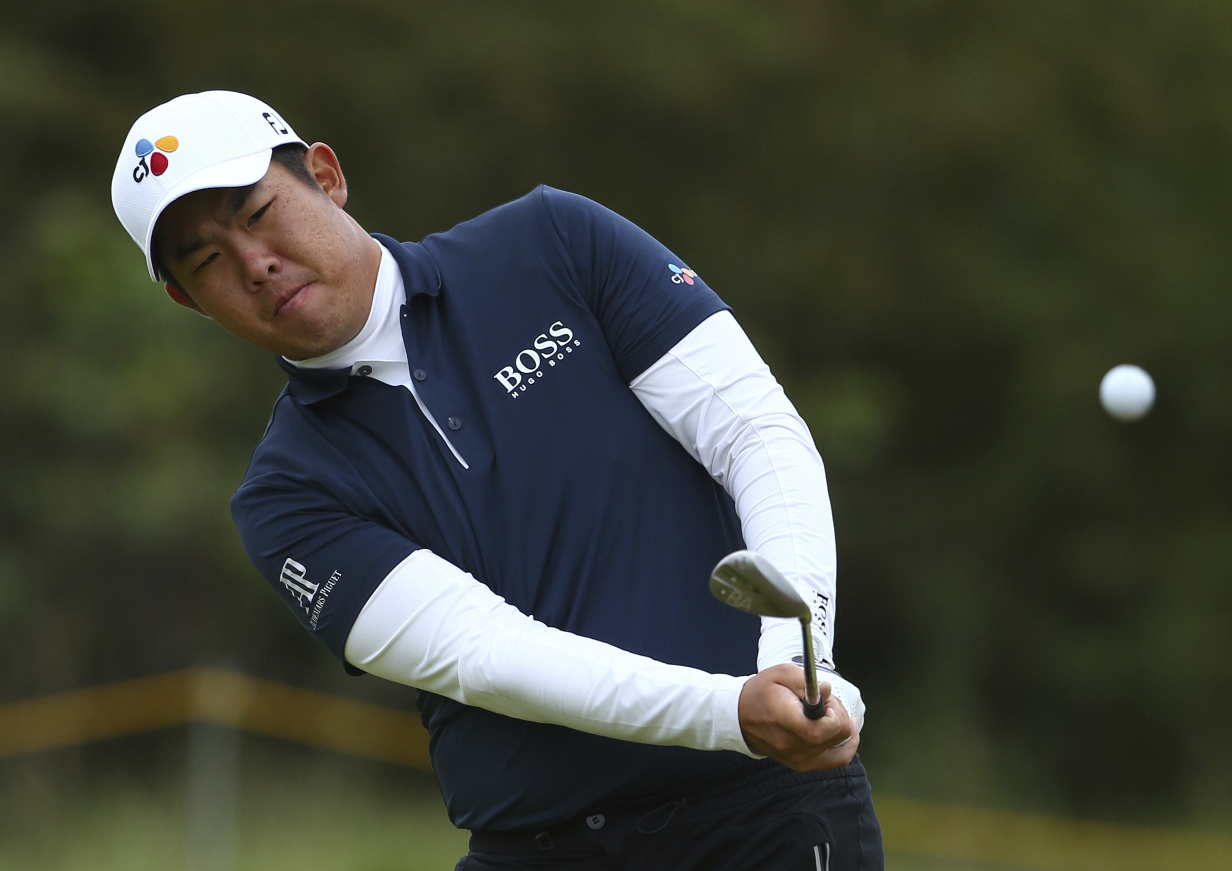 Korea's Byeong Hun An plays a shot on the 4th hole during the first round of the British Open Golf Championship, at Royal Birkdale, Southport, England Thursday, July 20, 2017. (AP Photo/Dave Thompson)