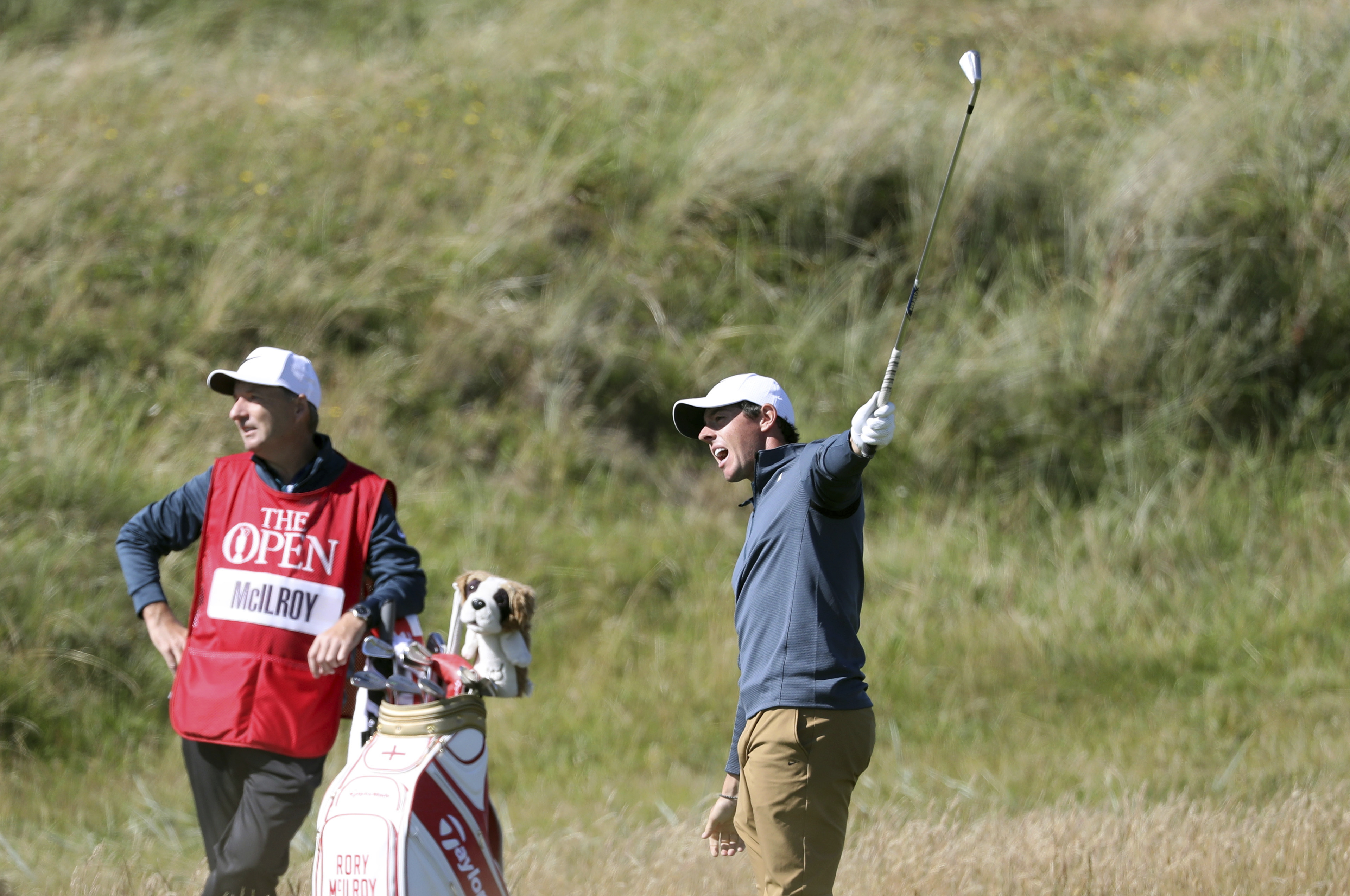 Northern Ireland's Rory McIlroy reacts after hitting a wayward shot on the 5th hole during the first round of the British Open Golf Championship, at Royal Birkdale, Southport, England Thursday, July 20, 2017. (AP Photo/Peter Morrison)