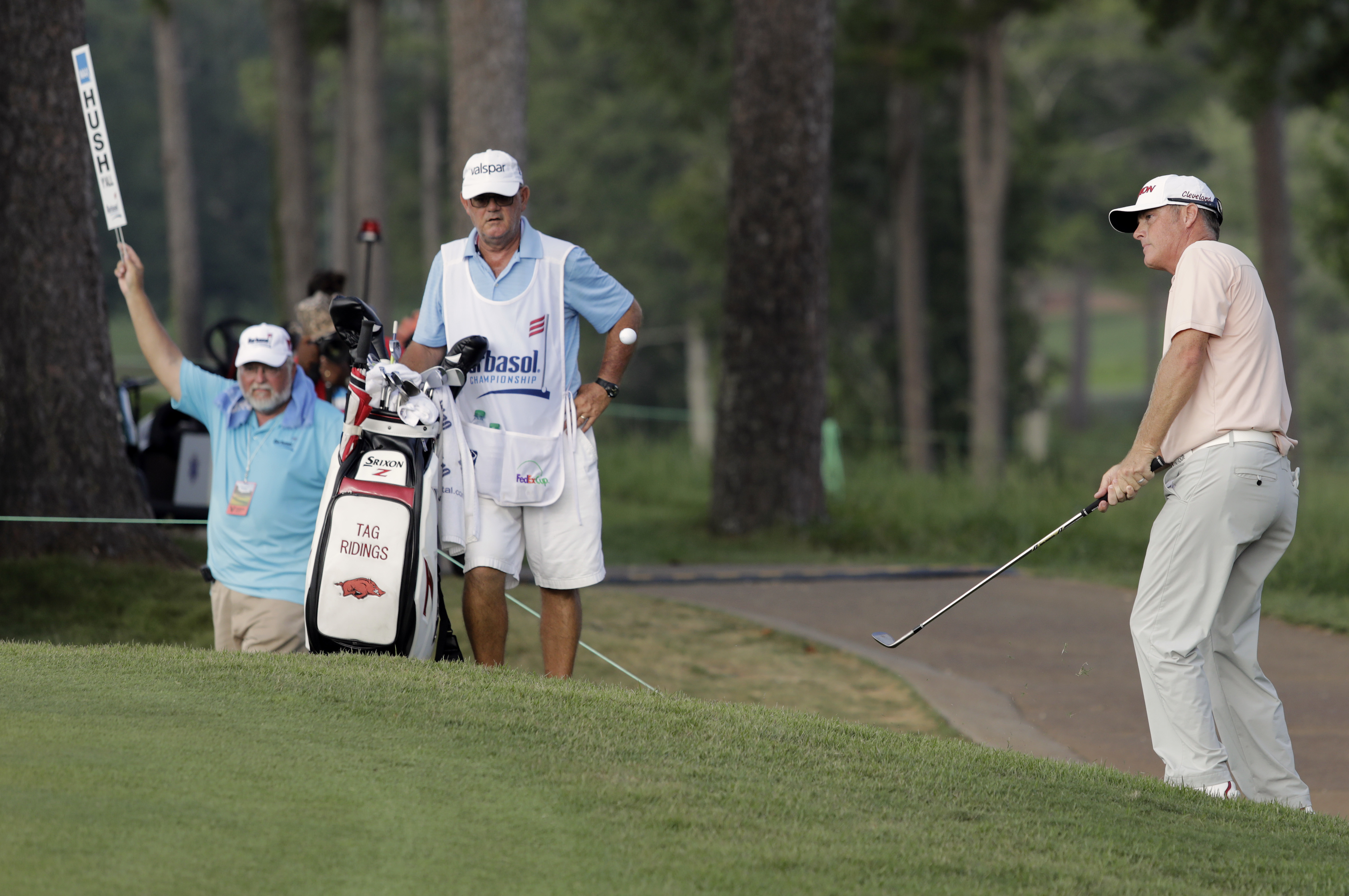 Tag Riding, right, chips to the green on 18 during the third round of the Barbasol Championship golf tournament Saturday, July 22, 2017, in Opelika, Ala. (Todd J. Van Emst/Opelika-Auburn News via AP)
