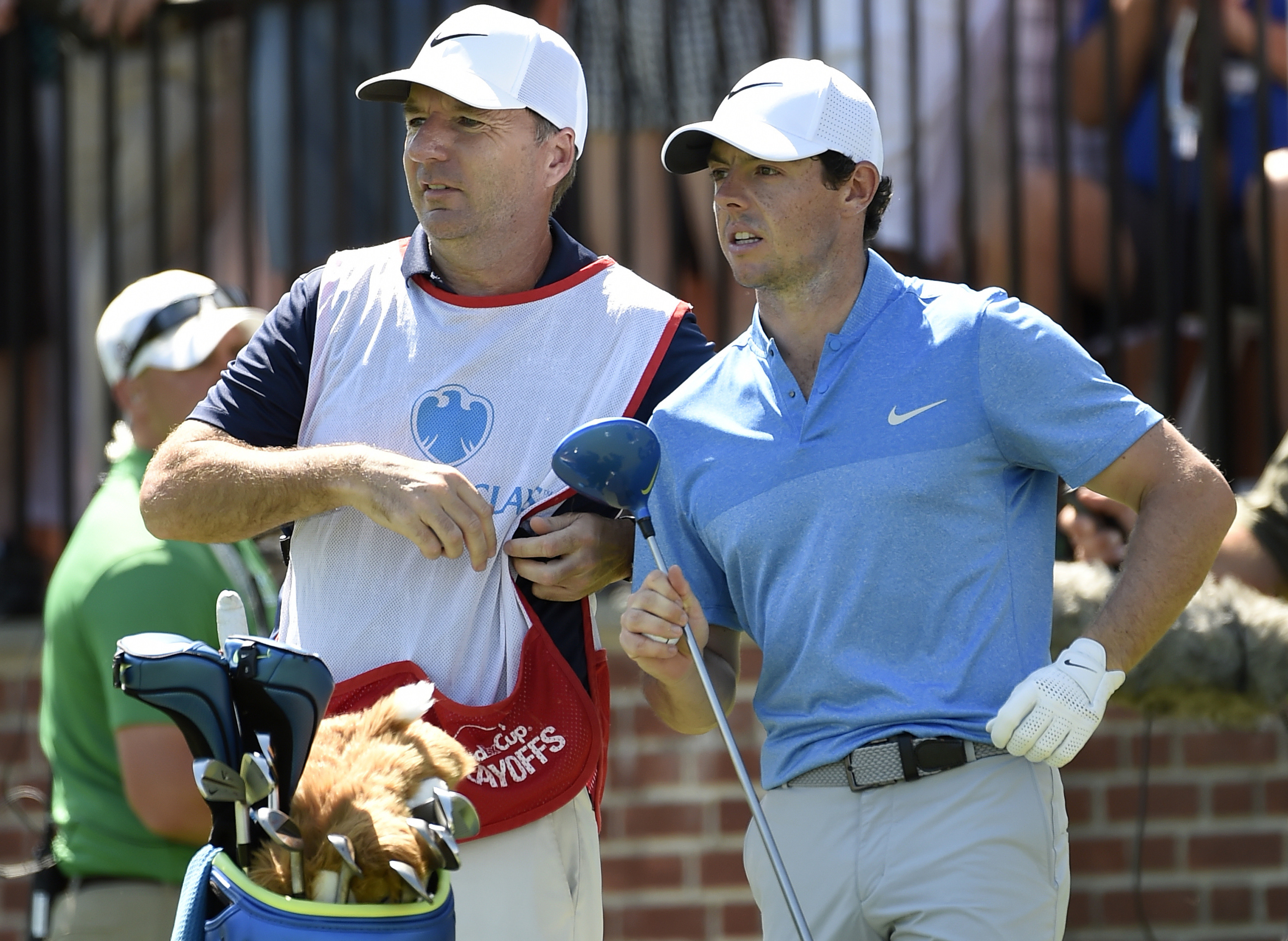 In this Aug. 28, 2016 photo, Rory McIlroy of Northern Ireland, right,  and his caddy, J. P. Fitzgerald look down the fairway before McIlroy tees off from the first hole during the final round of The Barclays golf tournament in Farmingdale, N.Y..  McIlroy