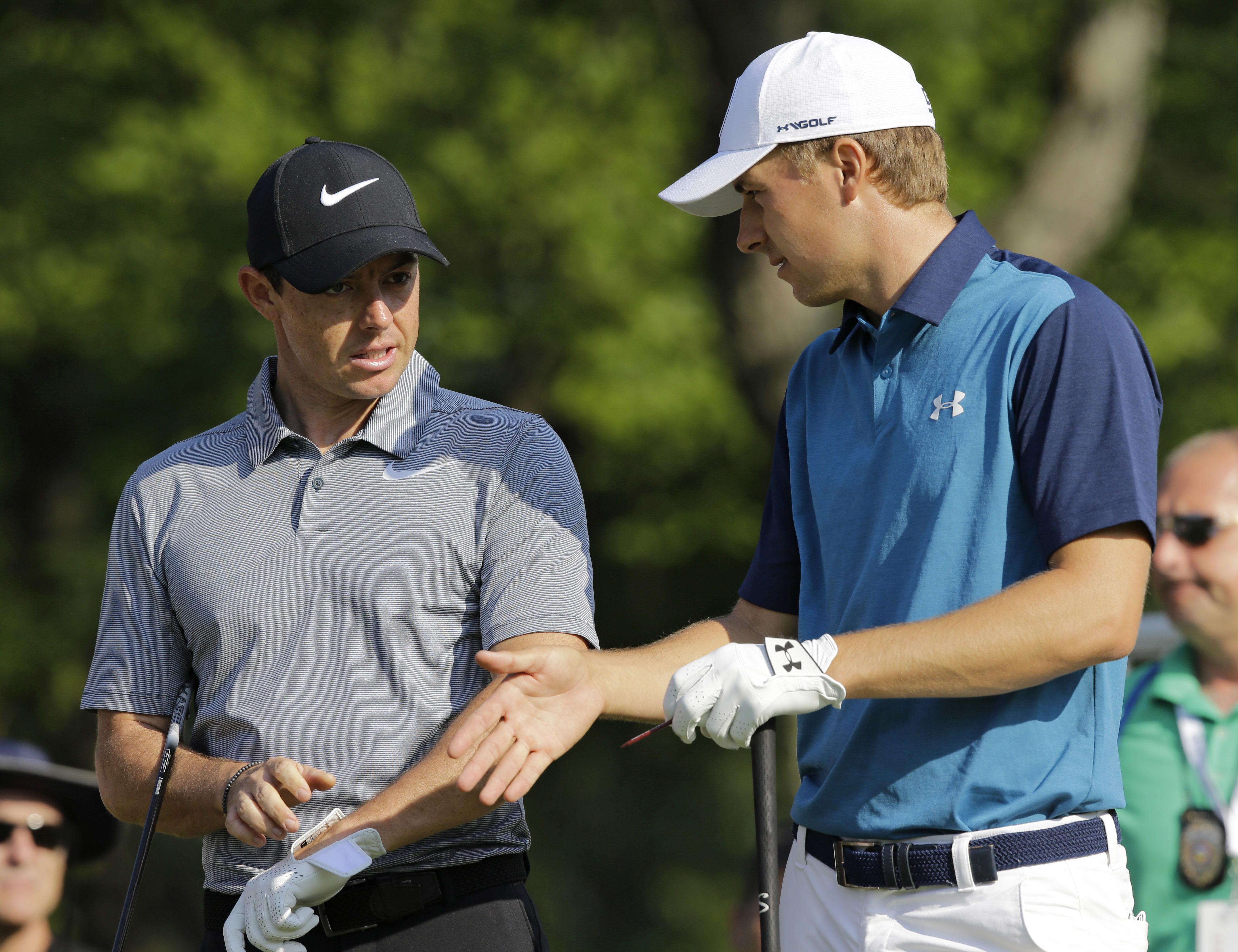 Jordan Spieth, right, and Rory McIlroy, from Northern Ireland, talk before teeing off on the 14th hole during the first round of the Bridgestone Invitational golf tournament at Firestone Country Club, Thursday, Aug. 3, 2017, in Akron, Ohio. (AP Photo/Tony