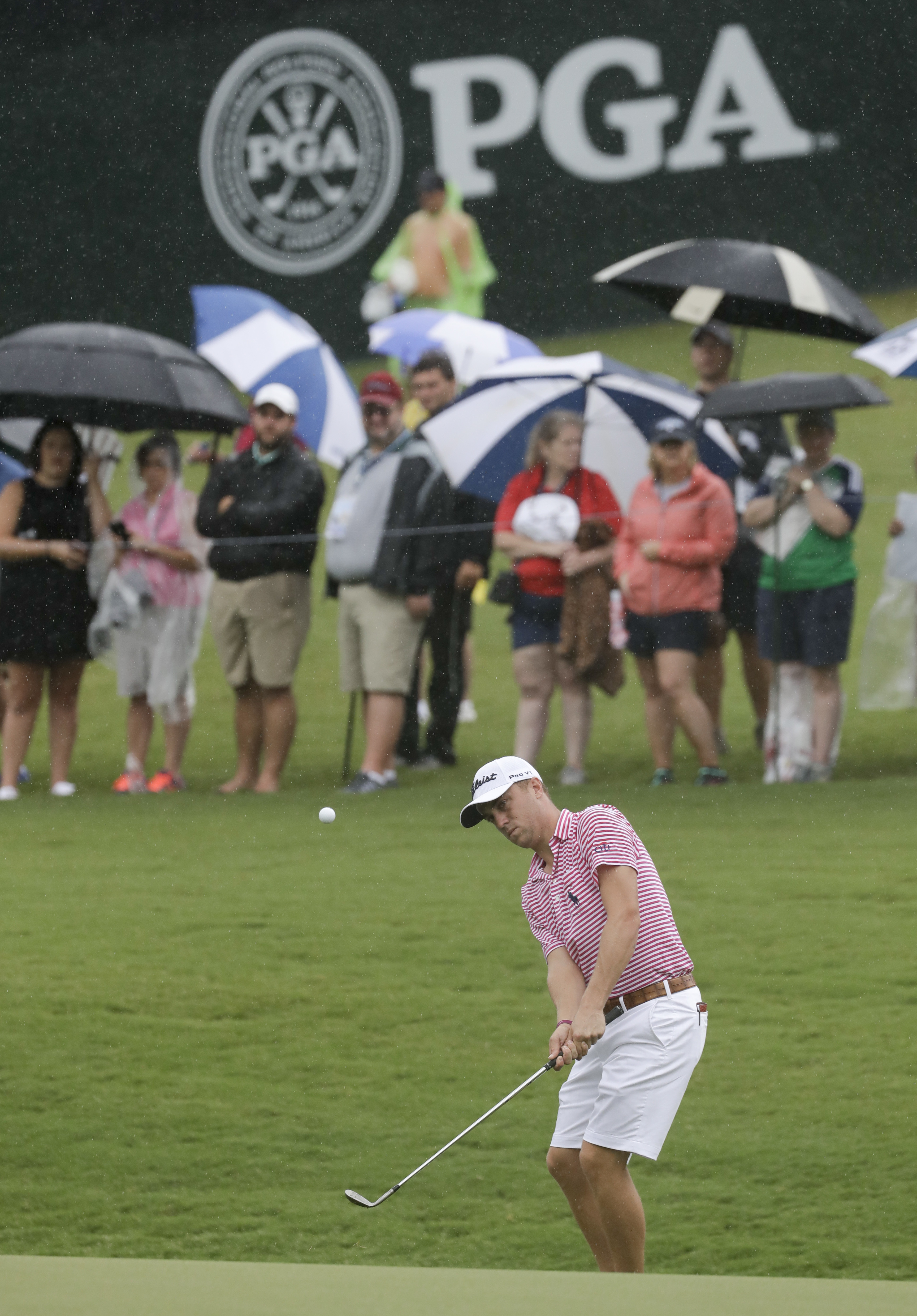 Justin Thomas chips to the 18th hole during a practice round for the PGA Championship at the Quail Hollow Club Tuesday, Aug. 8, 2017, in Charlotte, N.C. For the first time, the PGA Championship is letting players wear shorts in practice rounds. (AP Photo/