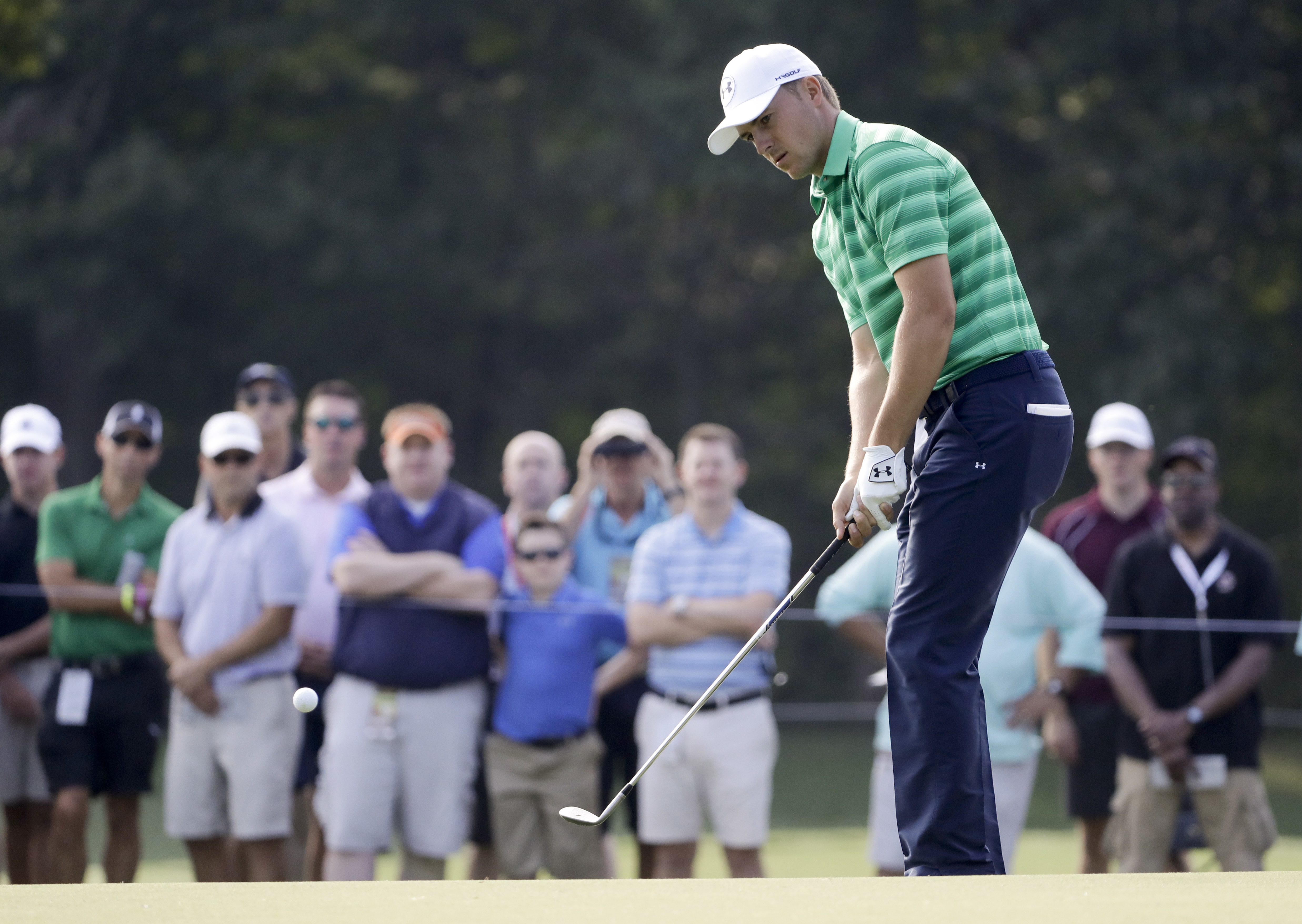 Jordan Spieth chips to the 11th green during the first round of the PGA Championship golf tournament at the Quail Hollow Club Thursday, Aug. 10, 2017, in Charlotte, N.C. (AP Photo/Chris O'Meara)