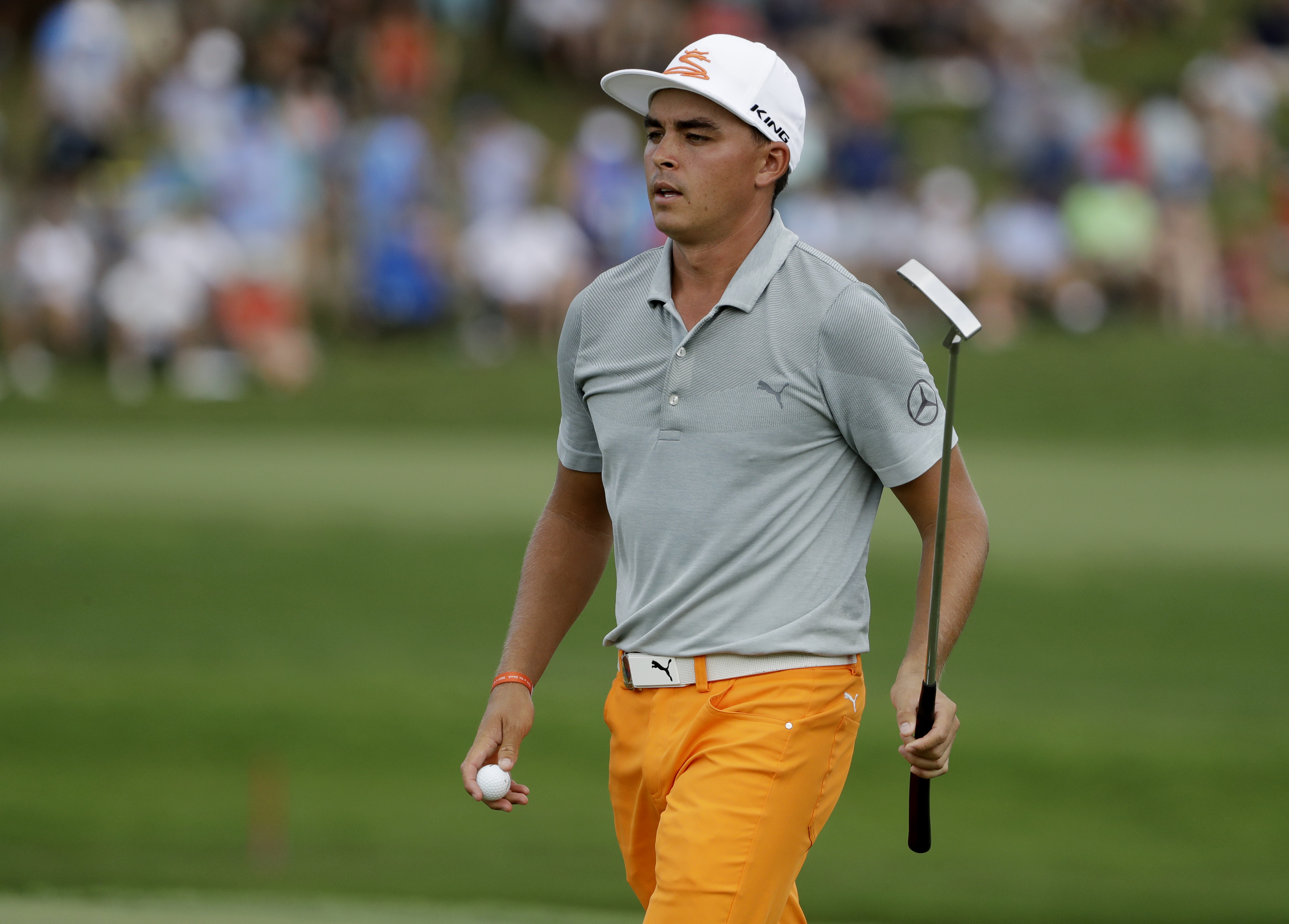 Rickie Fowler finishes the 16th hole during the final round of the PGA Championship golf tournament at the Quail Hollow Club Sunday, Aug. 13, 2017, in Charlotte, N.C. (AP Photo/Chris O'Meara)