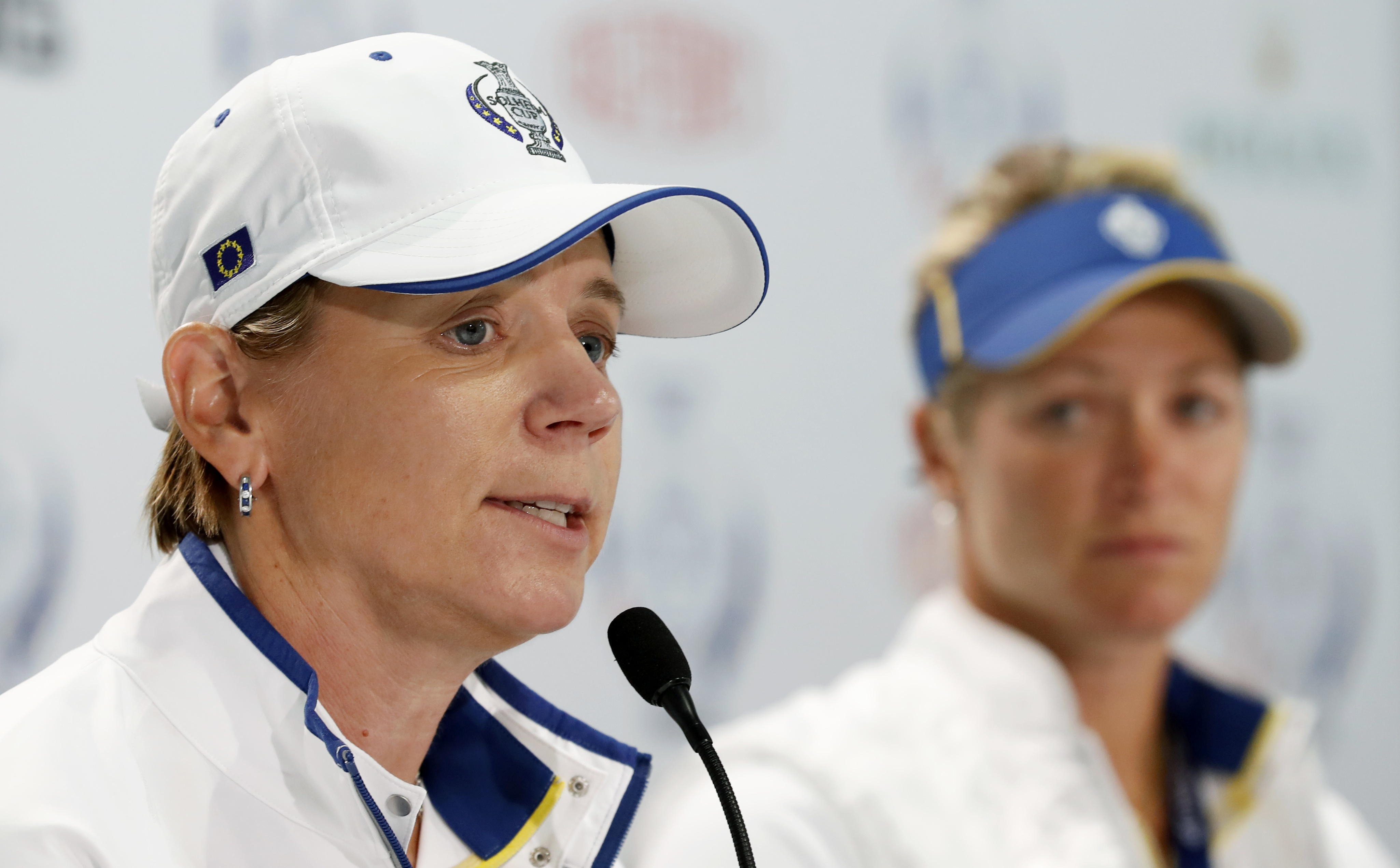 Europe captain Annika Sorenstam, of Sweden, speaks during a news conference for the Solheim Cup golf tournament as Europe's Suzann Pettersen, of Norway, right, looks on, Wednesday, Aug. 16, 2017, in West Des Moines, Iowa. Pettersen has pulled out of this