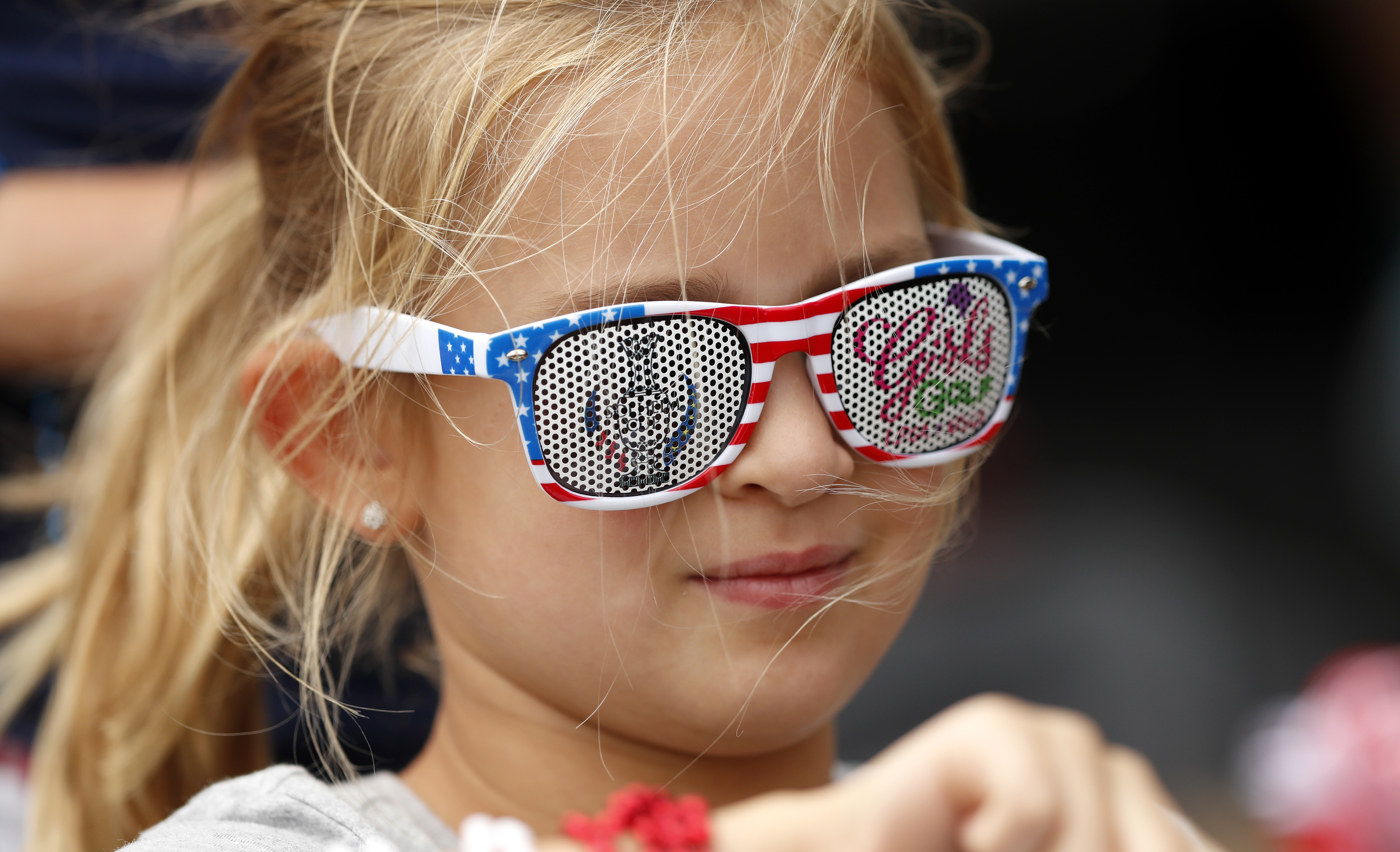 A young fan waits for an autograph during practice for the Solheim Cup golf tournament, Thursday, Aug. 17, 2017, in West Des Moines, Iowa. (AP Photo/Charlie Neibergall)