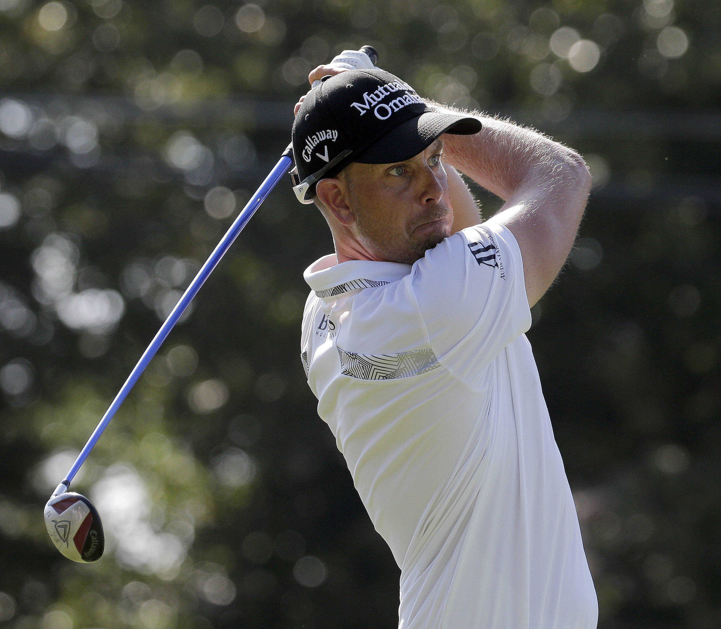 Henrik Stenson, of Sweden, watches his tee shot on the 18th hole during the second round of the Wyndham Championship golf tournament in Greensboro, N.C., Friday, Aug. 18, 2017. (AP Photo/Chuck Burton)
