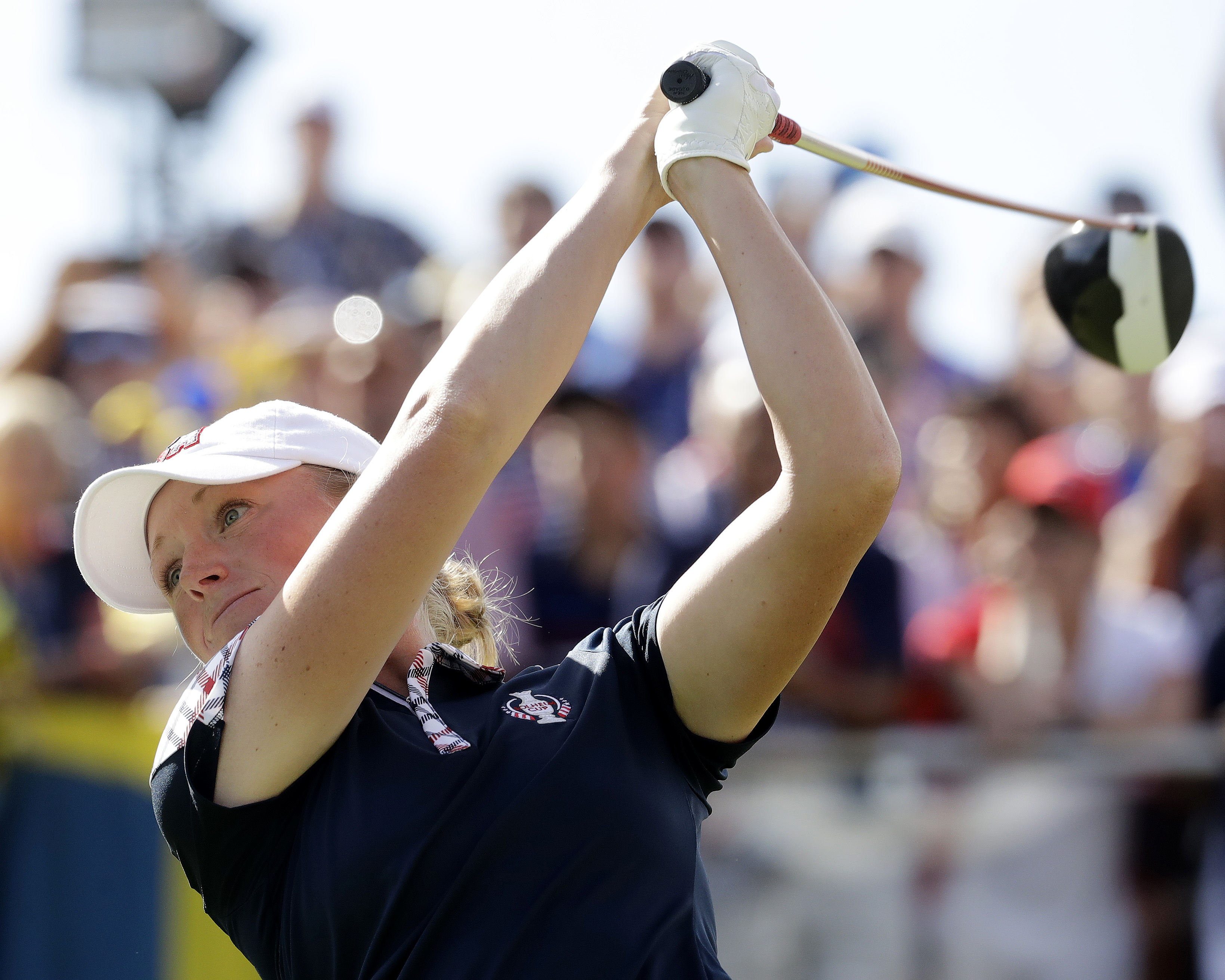 United States' Stacy Lewis tees on the first hole during her singles match against Europe's Catriona Matthew, of Scotland, in the Solheim Cup golf tournament, Sunday, Aug. 20, 2017, in West Des Moines, Iowa. (AP Photo/Charlie Riedel)