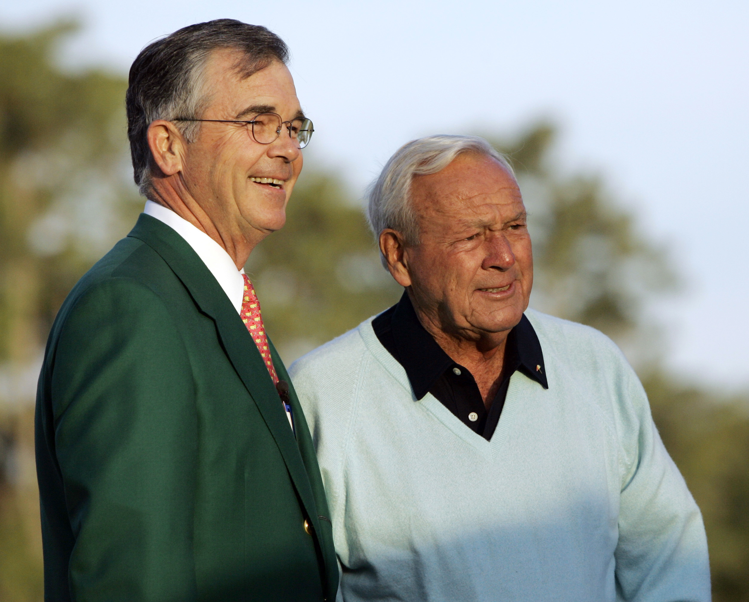 FILE - In this Thursday, April 5, 2007, file photo, Augusta National chairman Billy Payne, left, stands with honorary starter Arnold Palmer before the first round of the 2007 Masters golf tournament at the Augusta National Golf Club in Augusta, Ga. Payne