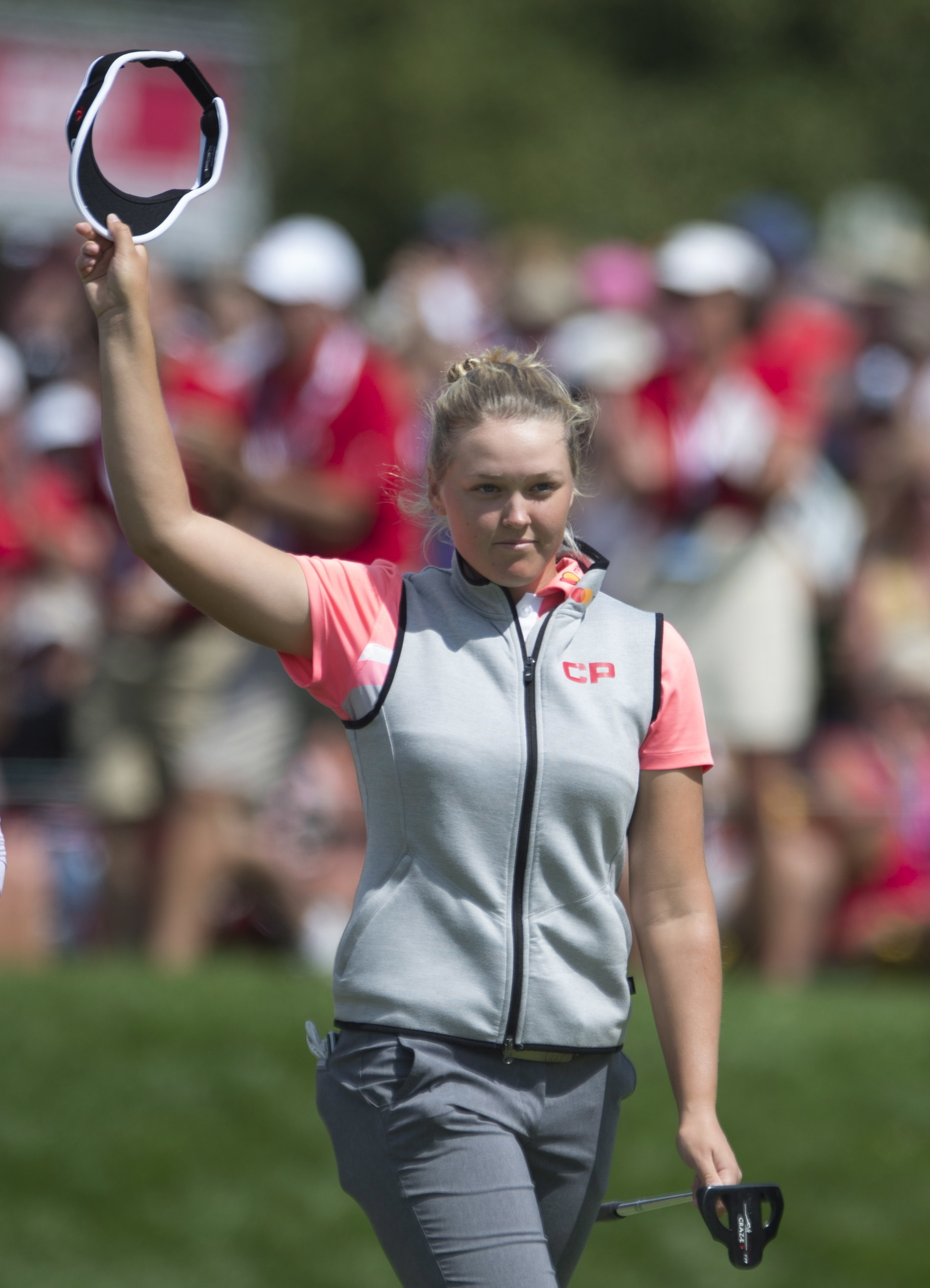 Canada's Brooke Henderson acknowledges the gallery after sinking a putt on the 18th green during third round play at the Canadian Pacific Women's Open in Ottawa, Saturday, Aug. 26, 2017. Henderson shot 8-under par Saturday to move up the standings. (Adria