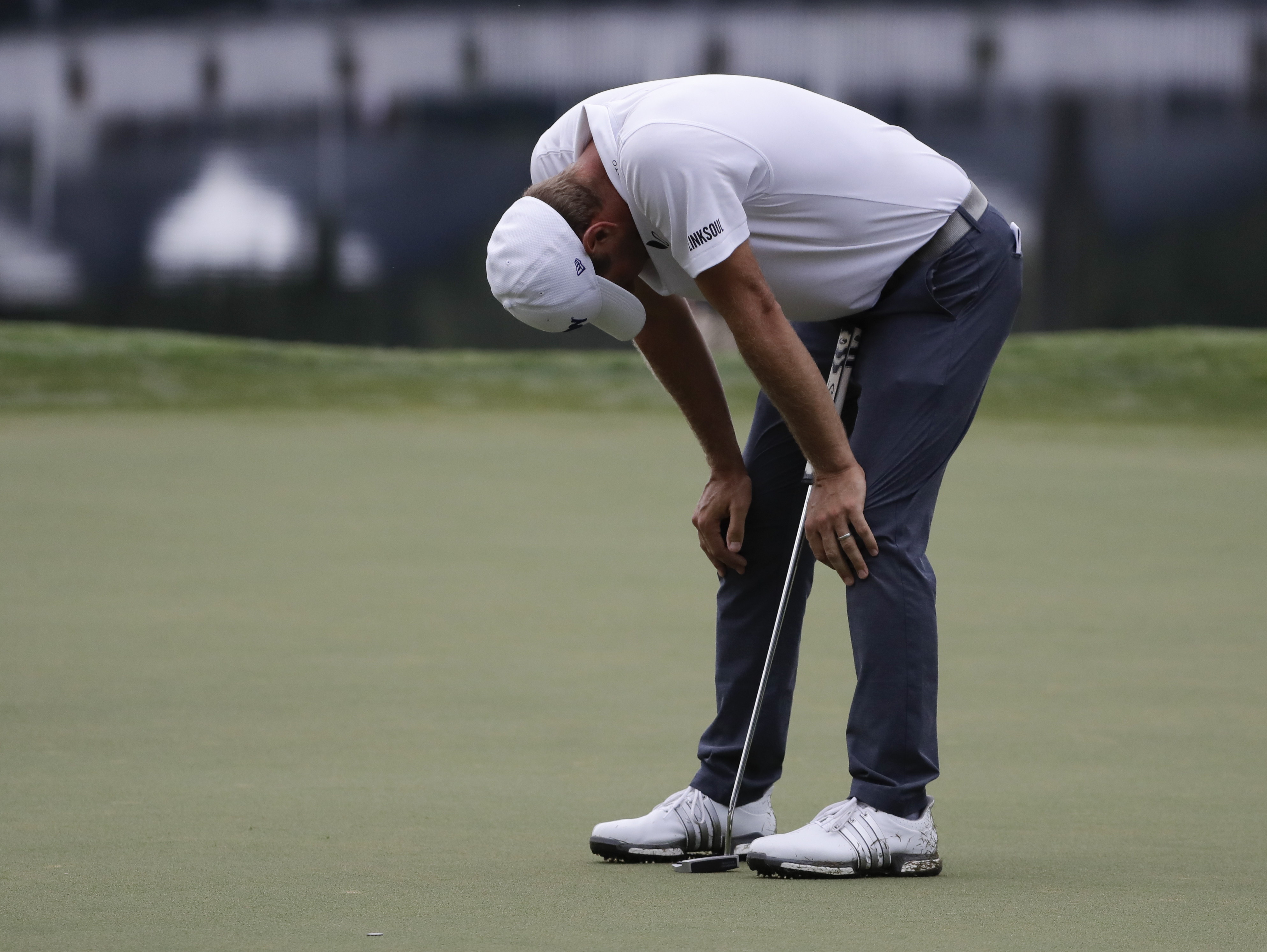 Lucas Glover reacts after missing a putt on the 14th hole during the second round of the PGA Championship golf tournament at the Quail Hollow Club Friday, Aug. 11, 2017, in Charlotte, N.C. (AP Photo/Chris O'Meara)