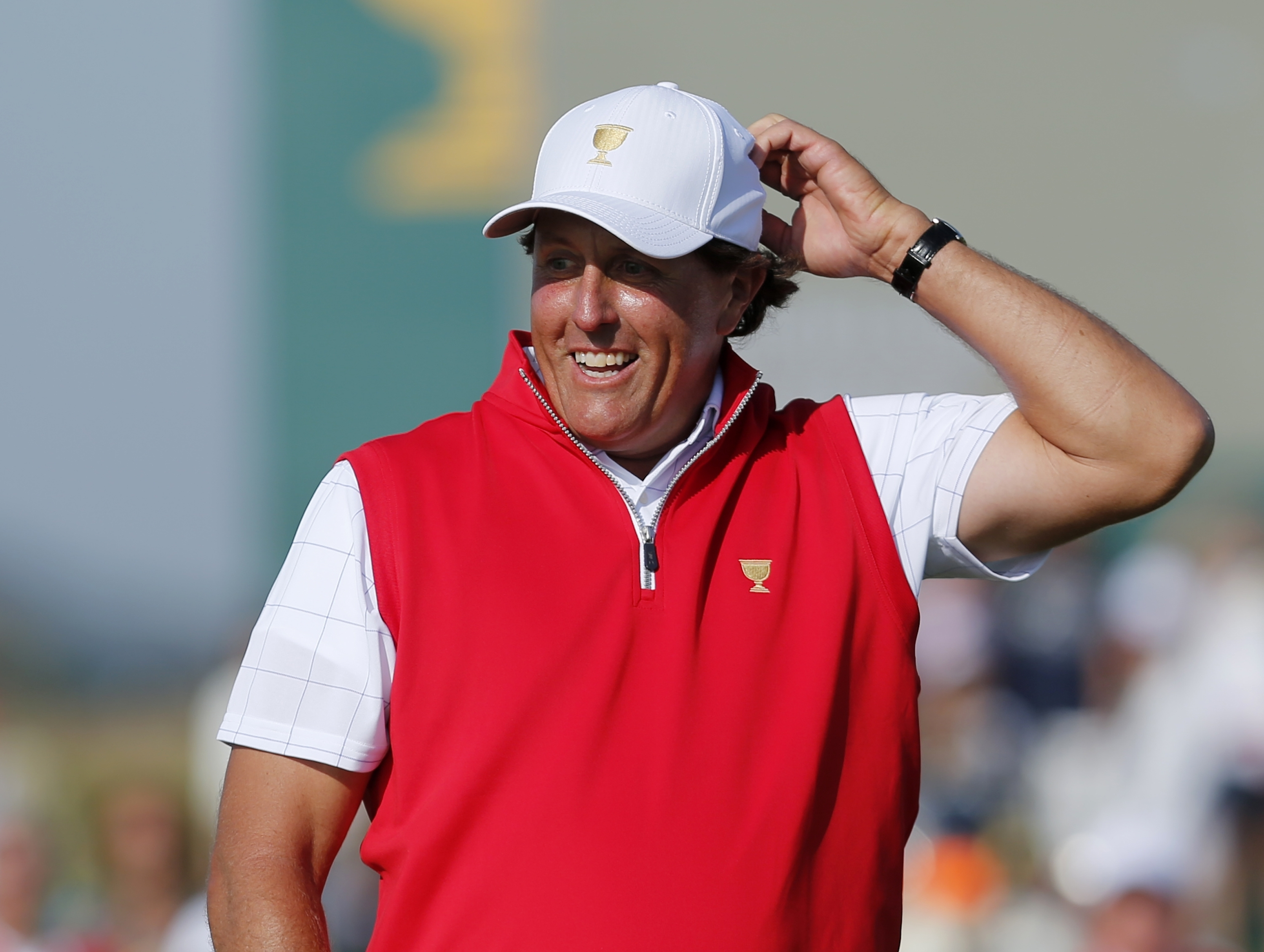 File-This Oct. 8, 2015, file photo shows United States' Phil Mickelson reacting to his putt on the 17th green during his foursome match at the Presidents Cup golf tournament at the Jack Nicklaus Golf Club Korea, in Incheon, South Korea. Mickelson  was a c