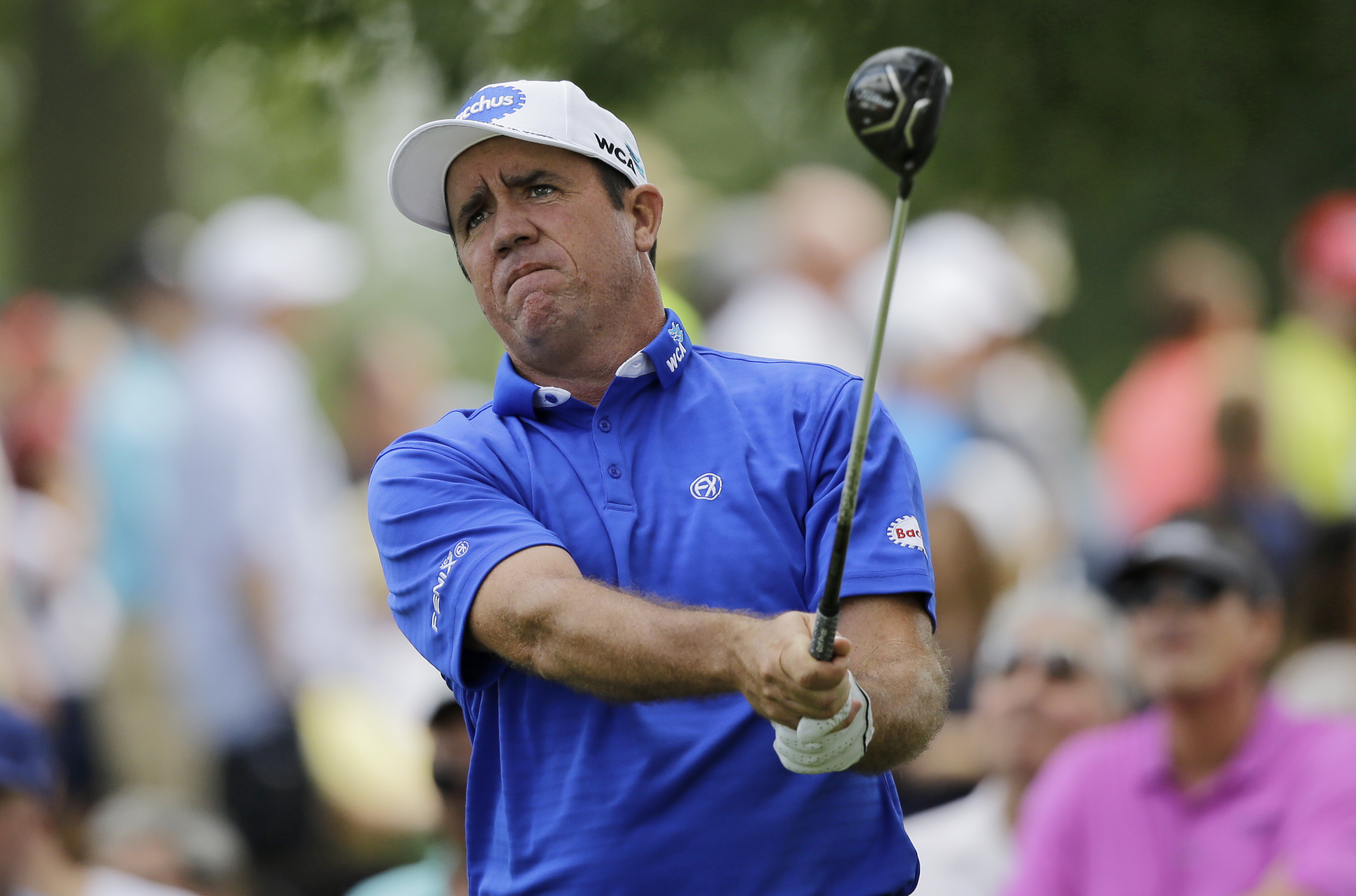 Scott Hend, from Australia, tees off on the 18th hole during the third round of the Bridgestone Invitational golf tournament at Firestone Country Club, Saturday, Aug. 5, 2017, in Akron, Ohio. (AP Photo/Tony Dejak)