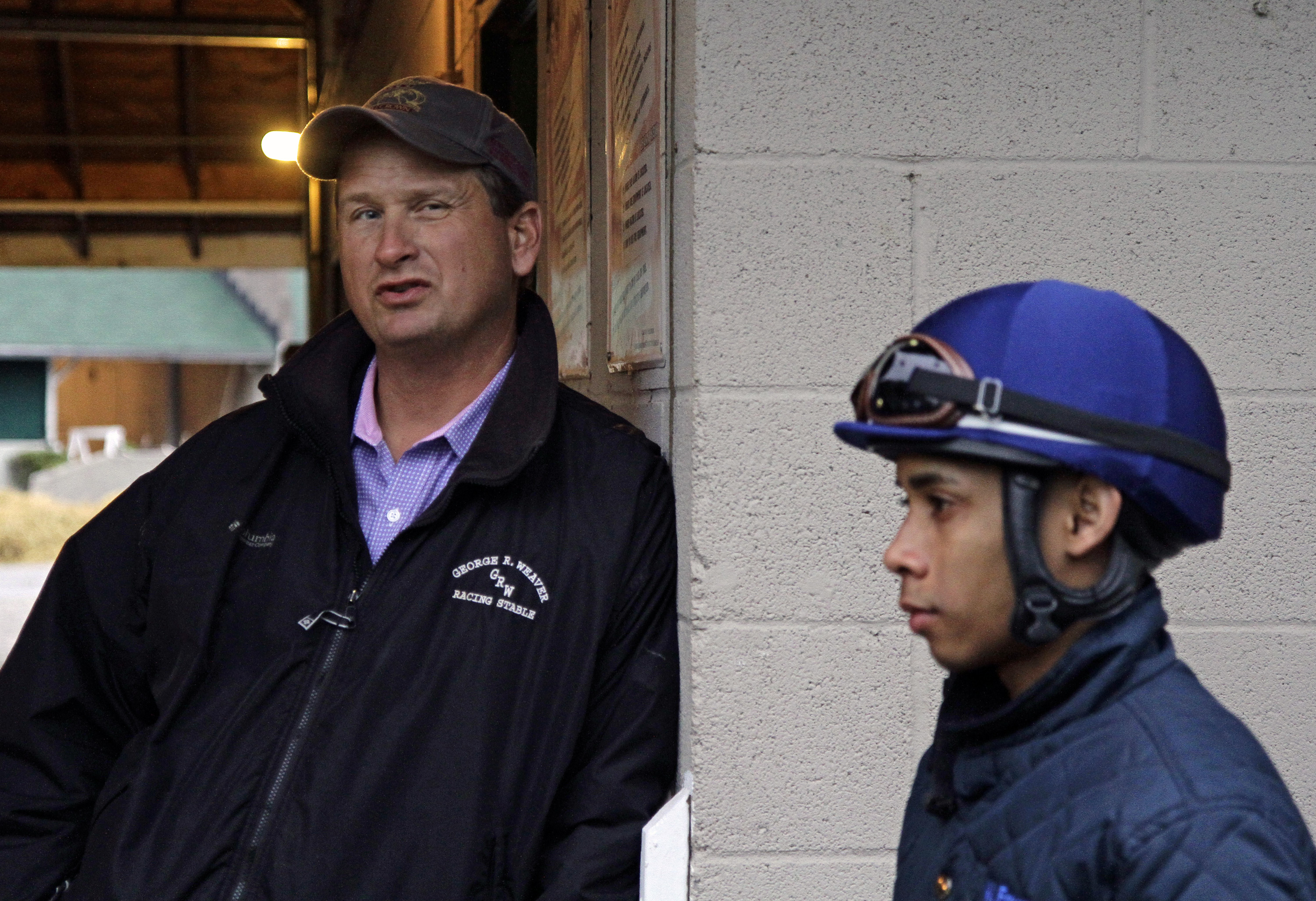 Trainer George Weaver, left, and jockey Manny Franco, right, discuss the morning workout by Kentucky Derby hopeful Tencendur at Churchill Downs in Louisville, Ky., Saturday, April 25, 2015.  (AP Photo/Garry Jones)