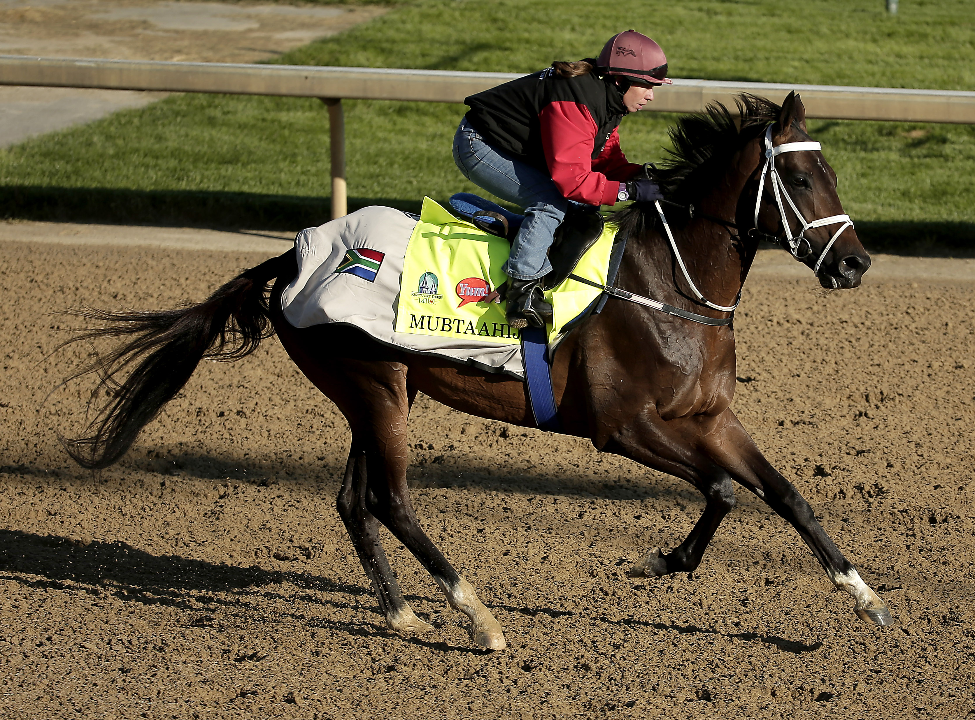 Kentucky Derby hopeful Mubtaahij is ridden by exercise rider Lisa Moncrieff during a morning workout at Churchill Downs Tuesday, April 28, 2015, in Louisville, Ky. (AP Photo/Charlie Riedel)