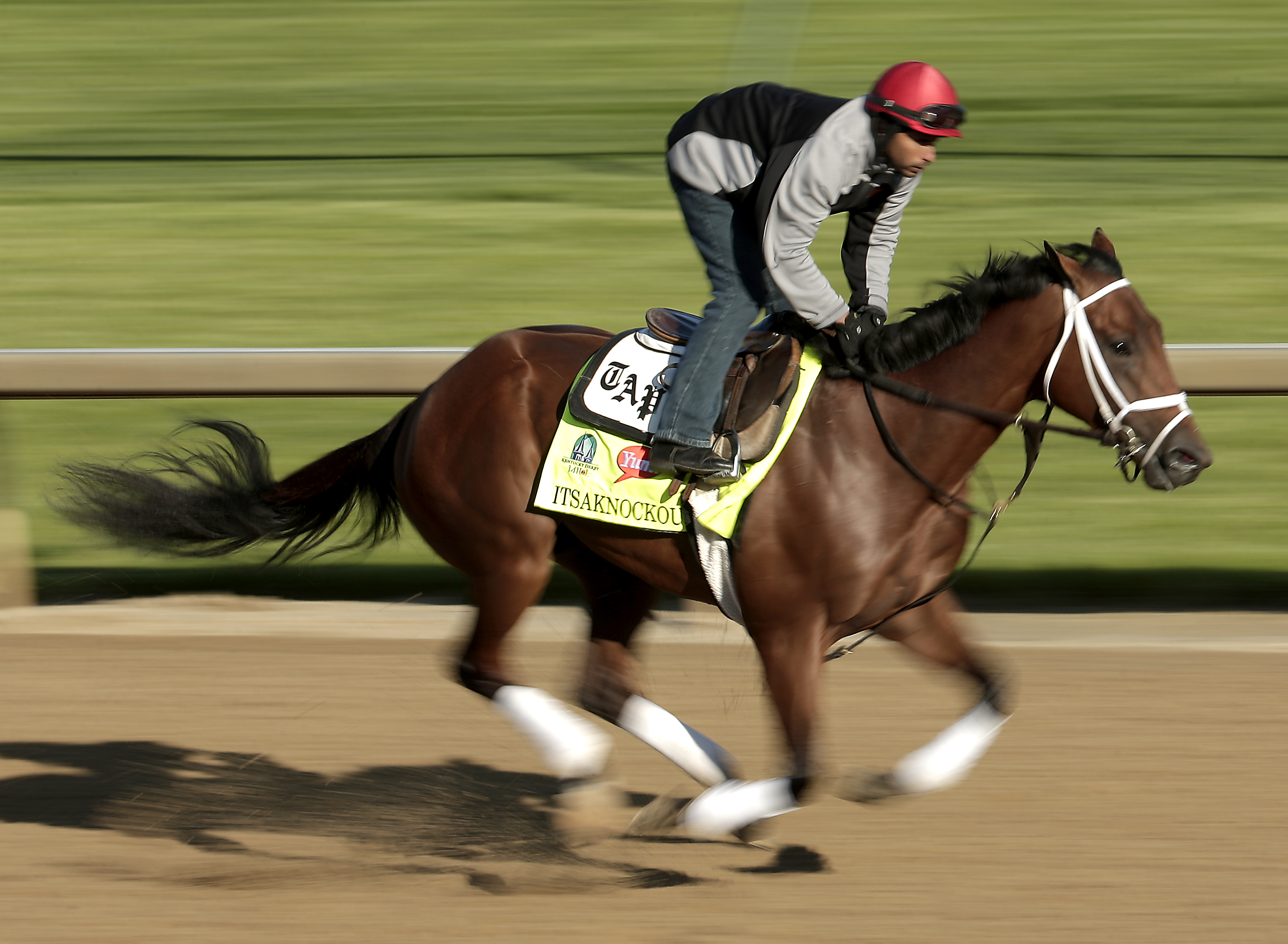 Kentucky Derby hopeful Itsaknockout is ridden by exercise rider Carlos Cano during a morning workout at Churchill Downs Tuesday, April 28, 2015, in Louisville, Ky. (AP Photo/Charlie Riedel)