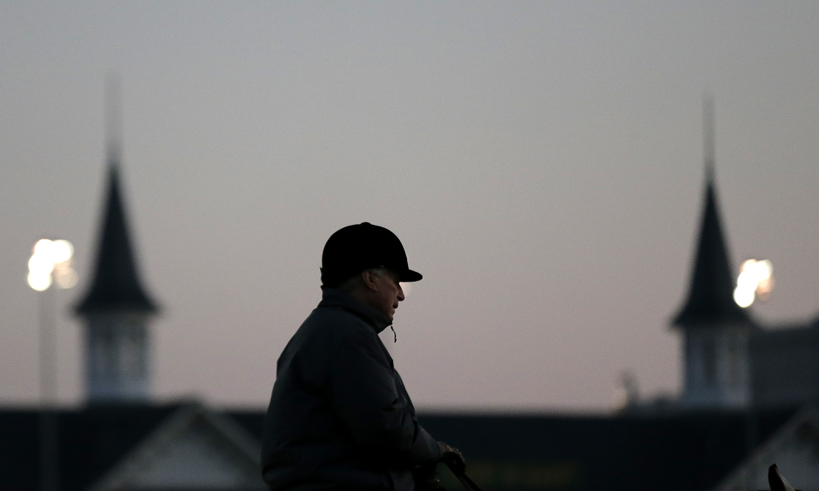 Trainer D. Wayne Lukas watches horses workout at Churchill Downs Tuesday, April 28, 2015, in Louisville, Ky. (AP Photo/Charlie Riedel)