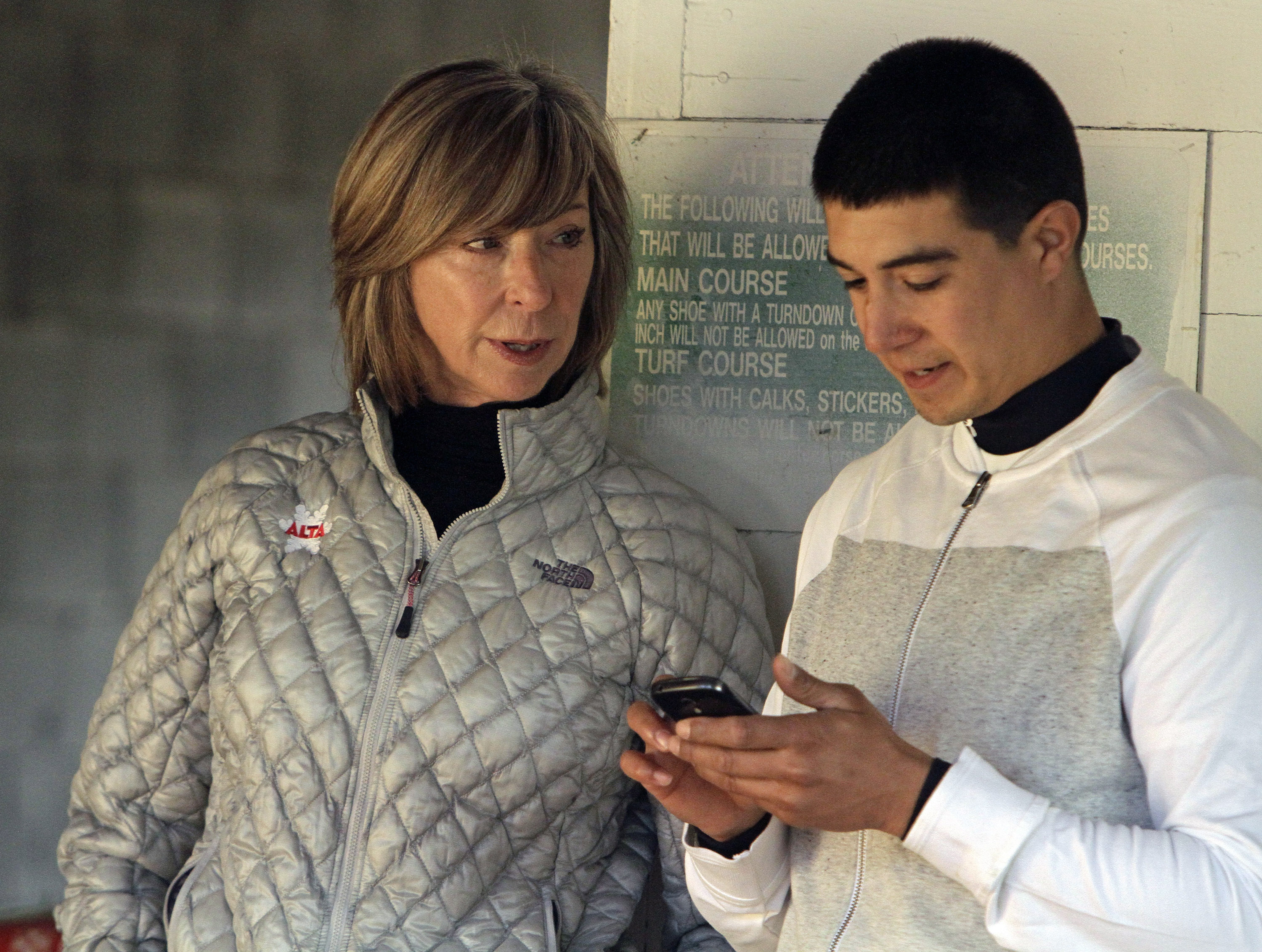 Trainer Carla Gaines, left, talks with exercise rider Tony Rubalcaba, right, before going to the track to gallop Kentucky Derby hopeful Bolo at Churchill Downs in Louisville, Ky., Wednesday, April 29, 2015.  (AP Photo/Garry Jones)