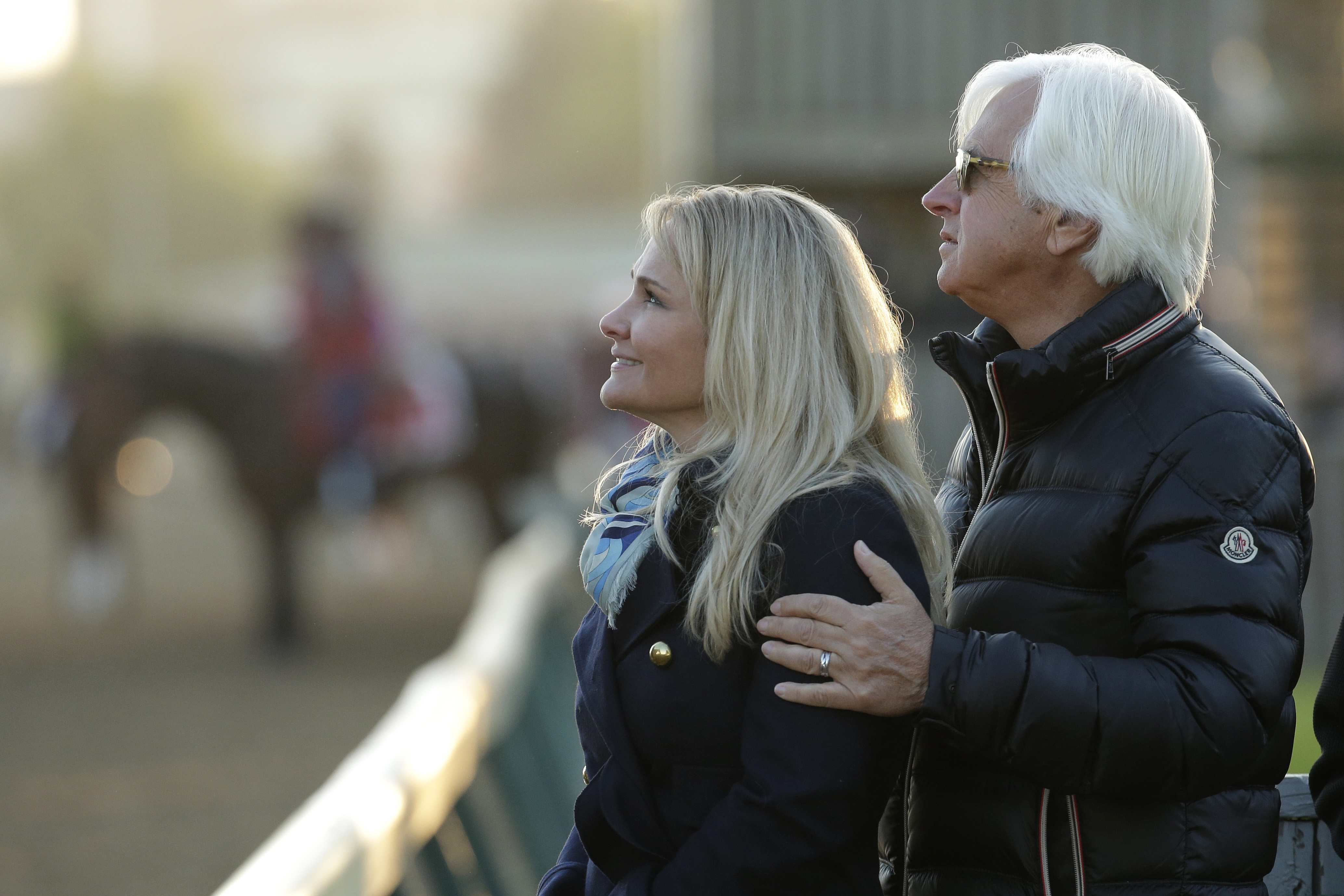 Trainer Bob Baffert and his wife Jill watch horses train on the track at Churchill Downs Wednesday, April 29, 2015, in Louisville, Ky. (AP Photo/Charlie Riedel)