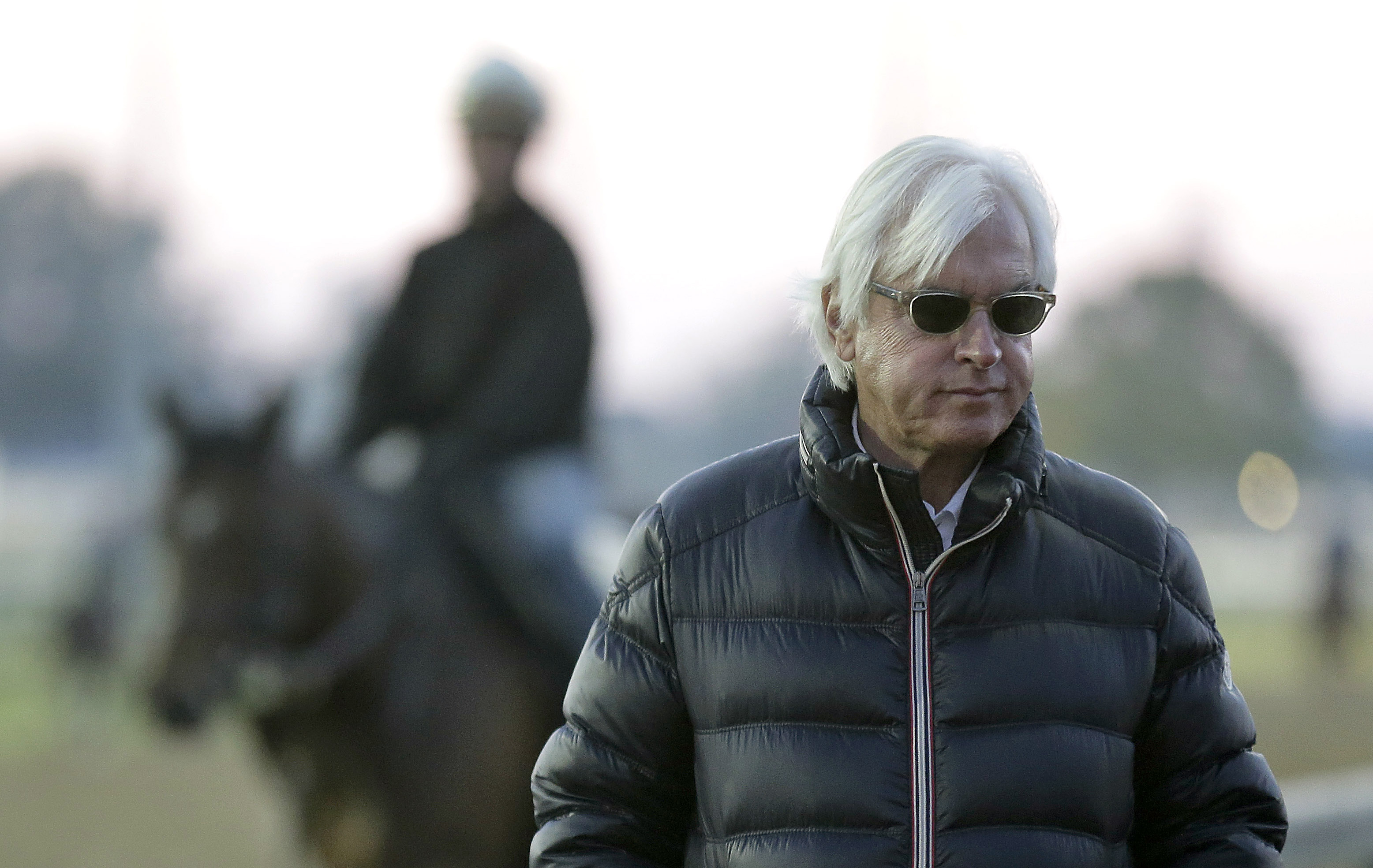 FILE - In this April 28, 2015 file photo, trainer Bob Baffert watches horses workout at Churchill Downs, in Louisville, Ky. Before Baffert won the Kentucky Derby for the first time, he lost.  Seize the moment is Baffert's mantra. Don't think about those g