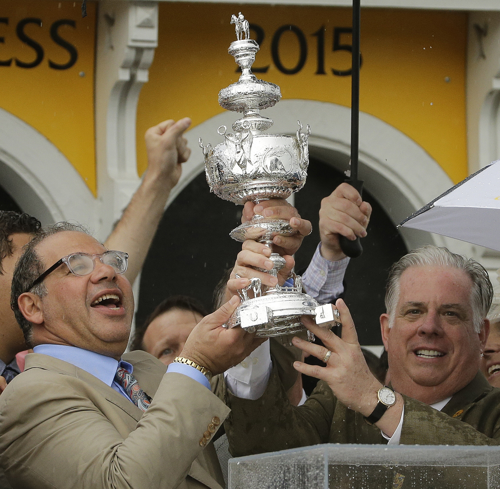 FILE - In this May 16, 2015 file photo, American Pharoah owner Ahmed Zayat, left, and Maryland Gov. Larry Hogan hold the Woodlawn Vase after American Pharoah with Victor Espinoza aboard won the 140th Preakness Stakes horse race at Pimlico Race Course,  in