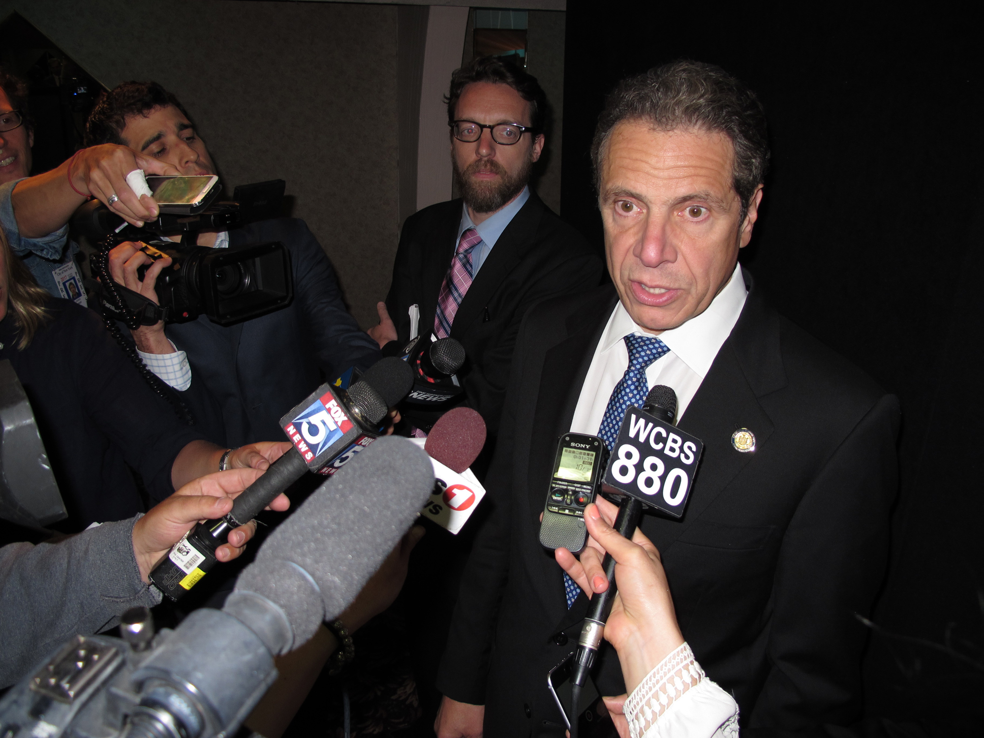 New York Gov. Andrew Cuomo speaks with reporters on Wednesday, June 3, 2015, in Seaford, N.Y. Cuomo said he supports New York Racing Association Chairman Anthony Bonomo's decision to take a leave of absence following revelations that Bonomo's company alle