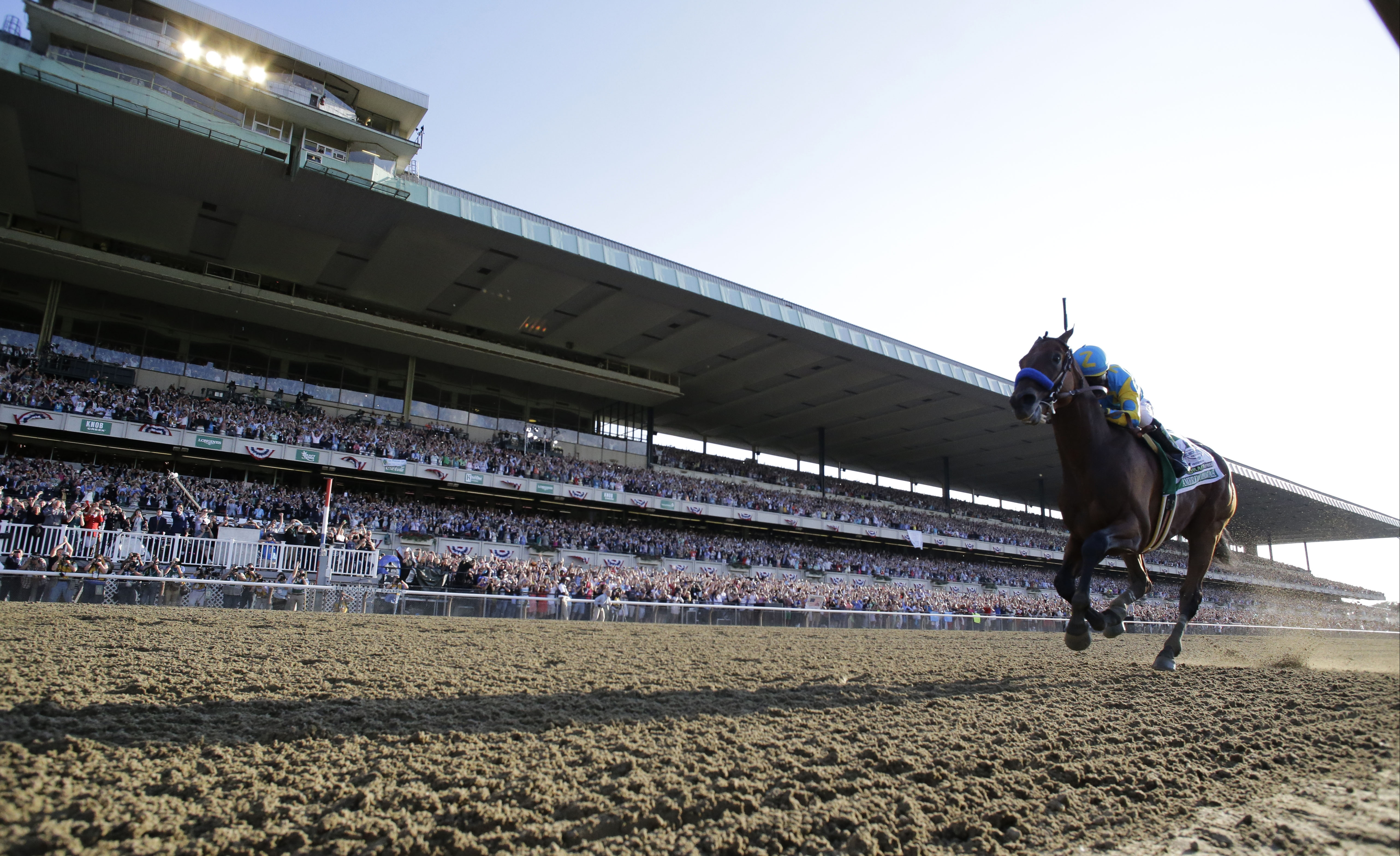 American Pharoah with Victor Espinoza up crosses the finish line to win the 147th running of the Belmont Stakes horse race at Belmont Park, Saturday, June 6, 2015, in Elmont, N.Y. American Pharoah won the race to become the first horse to win the Triple C